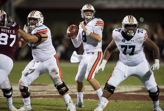 Auburn's Jarrett Stidham (8) looks to pass the ball down the field at Davis Wade Stadium in Starkville, Miss., on Saturday, Oct. 6, 2018. Mississippi State defeated Auburn 23-9.