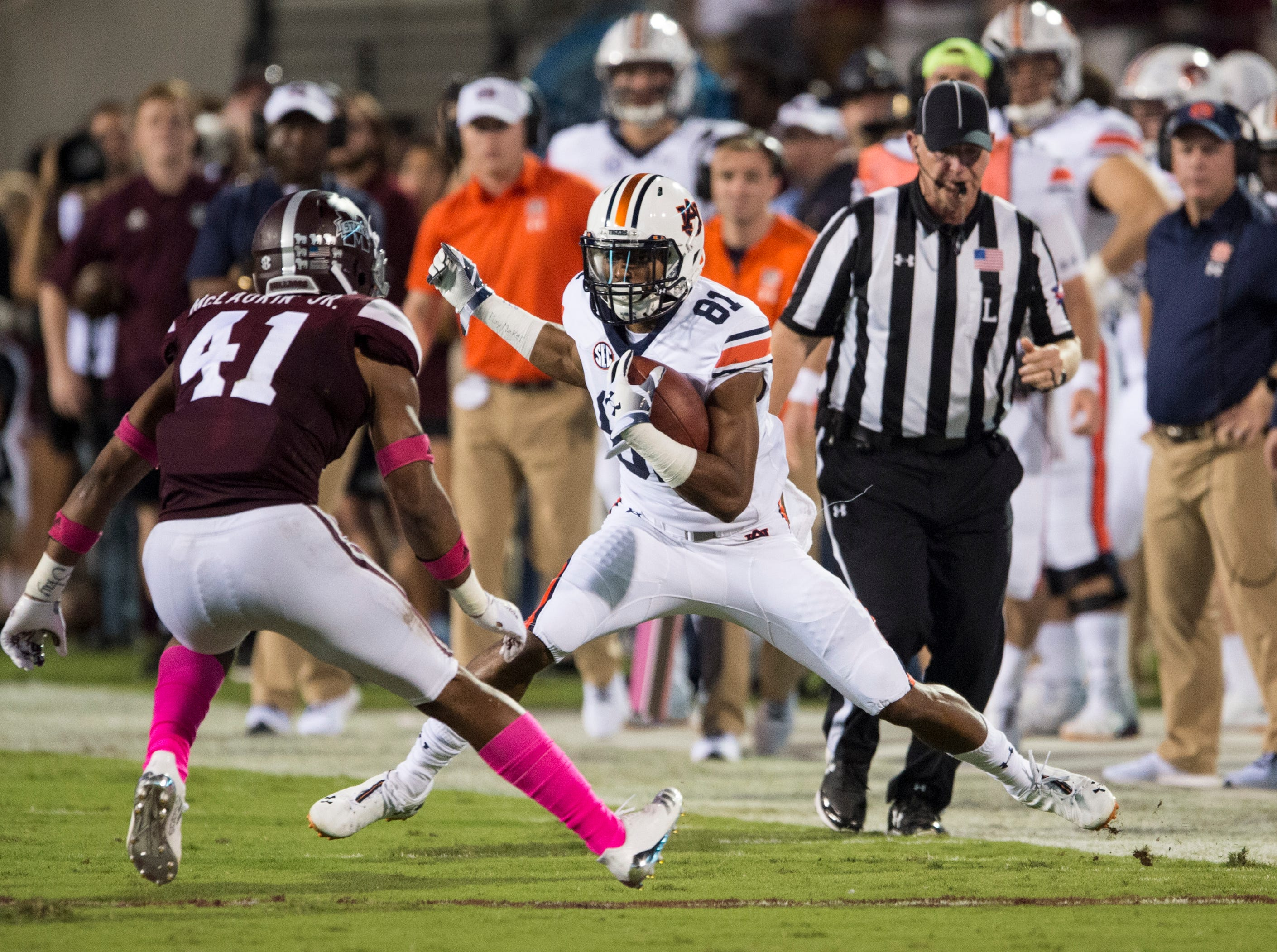 Auburn's Darius Slayton (81) steps out of bounds as he attempts to juke Mississippi State's Mark McLaurin (41) at Davis Wade Stadium in Starkville, Miss., on Saturday, Oct. 6, 2018. Mississippi State leads Auburn 13-3 at halftime.