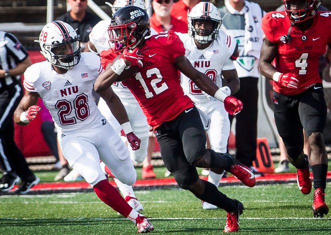 Ball State's Justin Hall runs the ball against Northern Illinois defense during their game at Scheumann Stadium Saturday, Oct. 6, 2018.