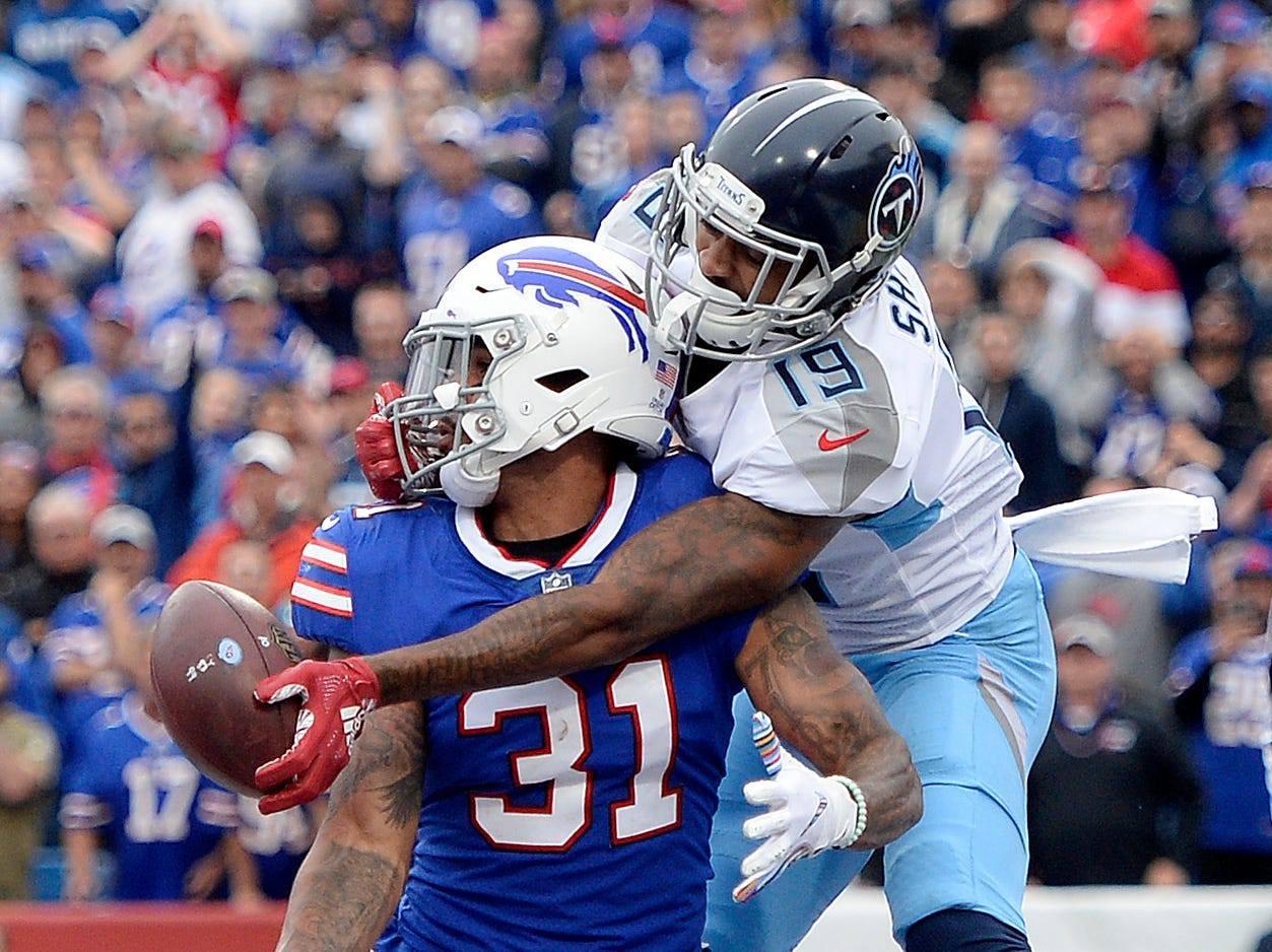 Worst loss: Bills 13, Titans 12 (Oct. 7 in Buffalo) -- Tennessee Titans wide receiver Tajae Sharpe, right, reaches but is unable to make a catch as Buffalo Bills safety Dean Marlowe defends during the second half of an NFL football game, Sunday, Oct. 7, 2018, in Orchard Park, N.Y.