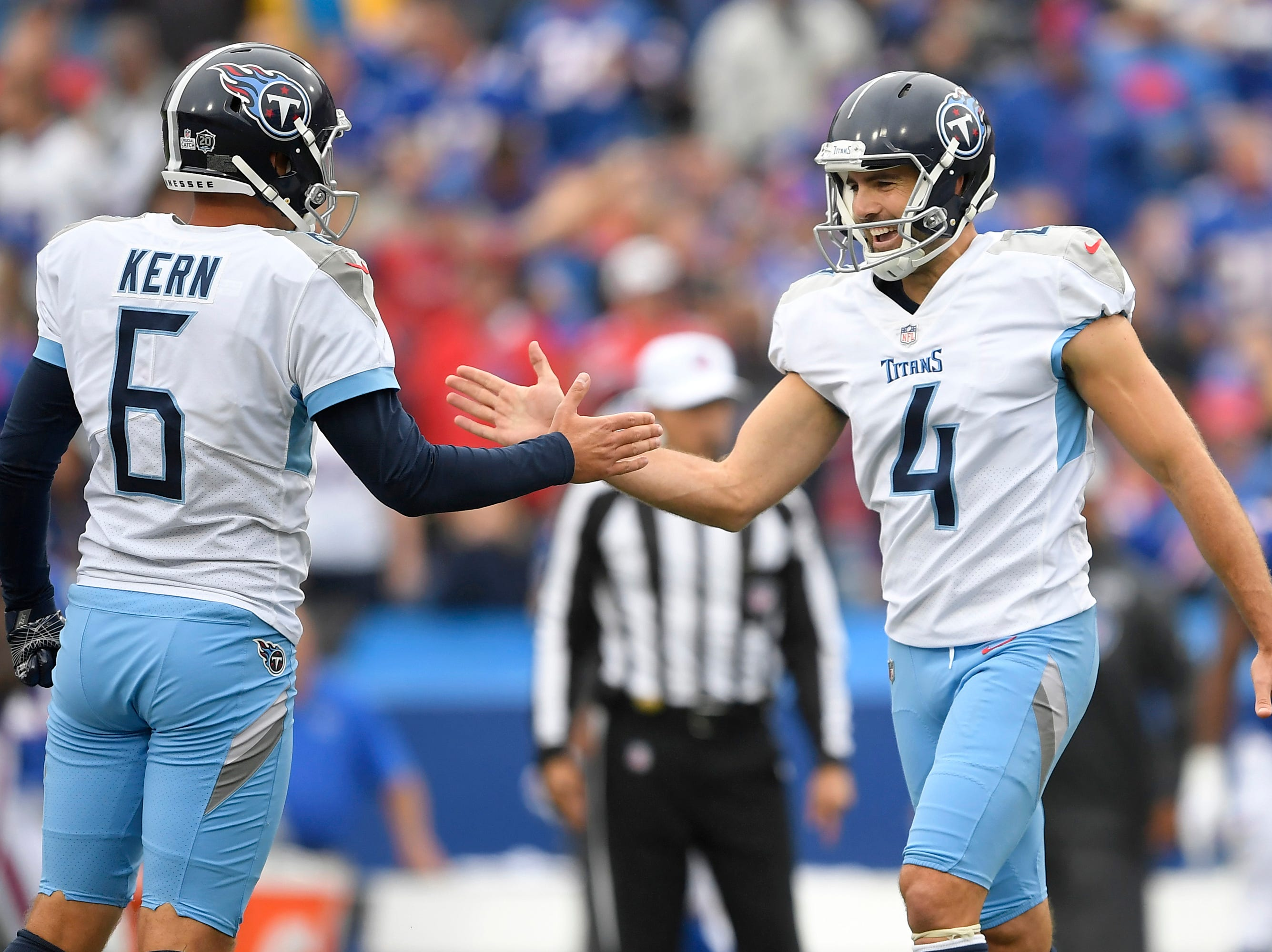 Tennessee Titans kicker Ryan Succop (4) celebrates his field goal with Brett Kern (6) during the first half of an NFL football game against the Buffalo Bills, Sunday, Oct. 7, 2018, in Orchard Park, N.Y. (AP Photo/Adrian Kraus)