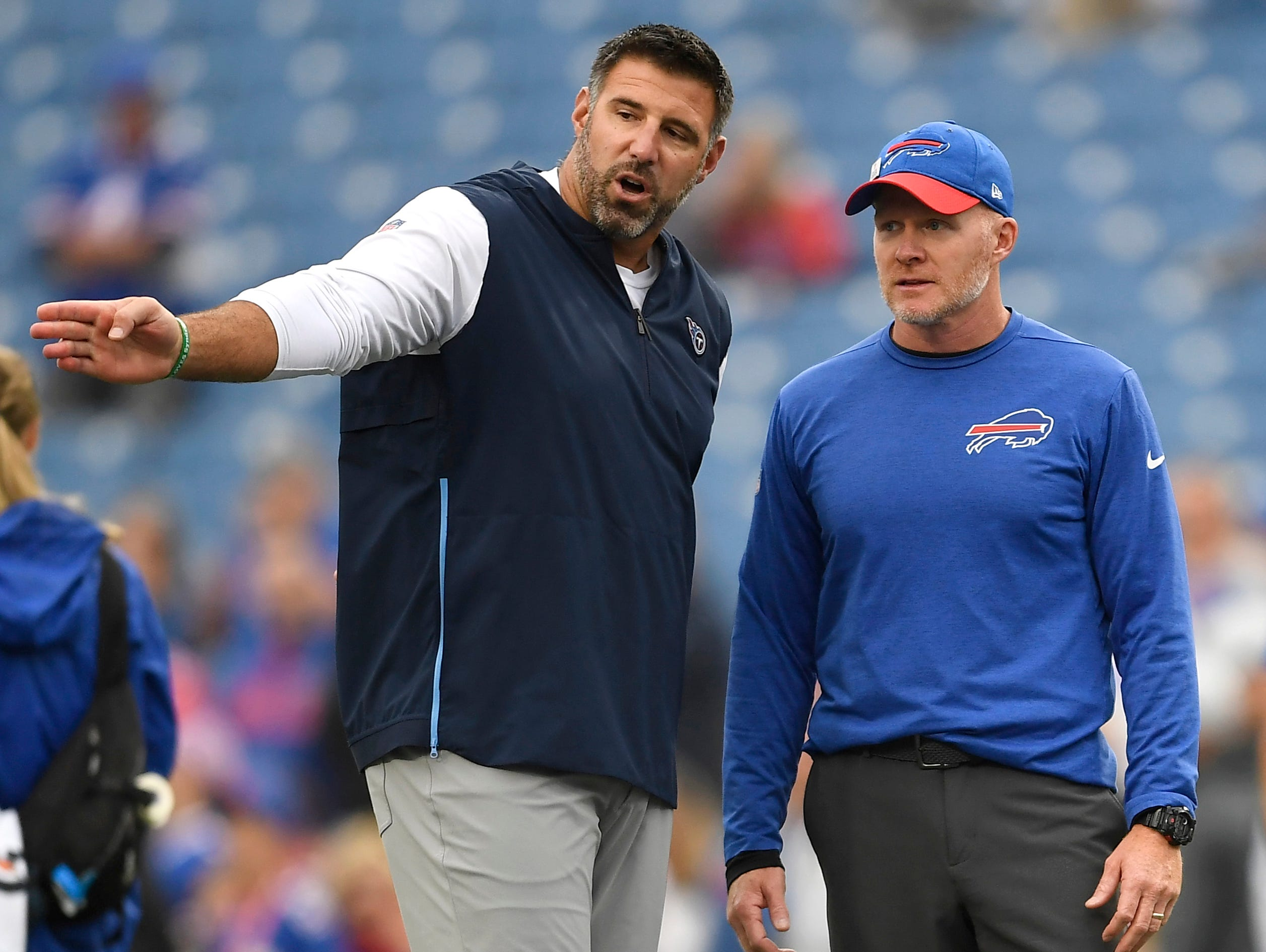 Tennessee Titans head coach Mike Vrabel, left, talks to Buffalo Bills head coach Sean McDermott prior to an NFL football game, Sunday, Oct. 7, 2018, in Orchard Park, N.Y. (AP Photo/Adrian Kraus)
