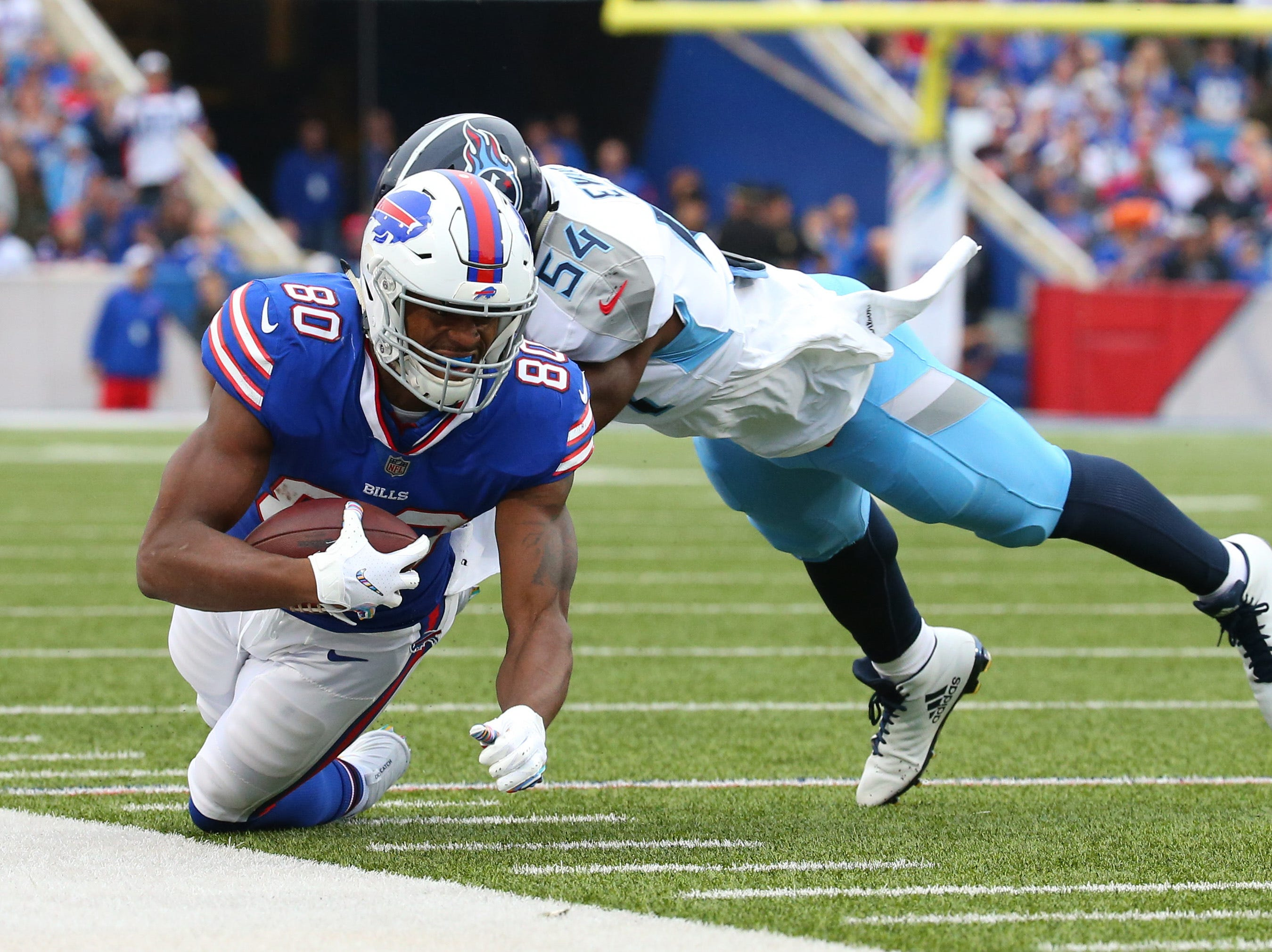 Oct 7, 2018; Orchard Park, NY, USA; Buffalo Bills tight end Jason Croom (80) dives for extra yards against Tennessee Titans linebacker Rashaan Evans (54) during the first quarter at New Era Field.