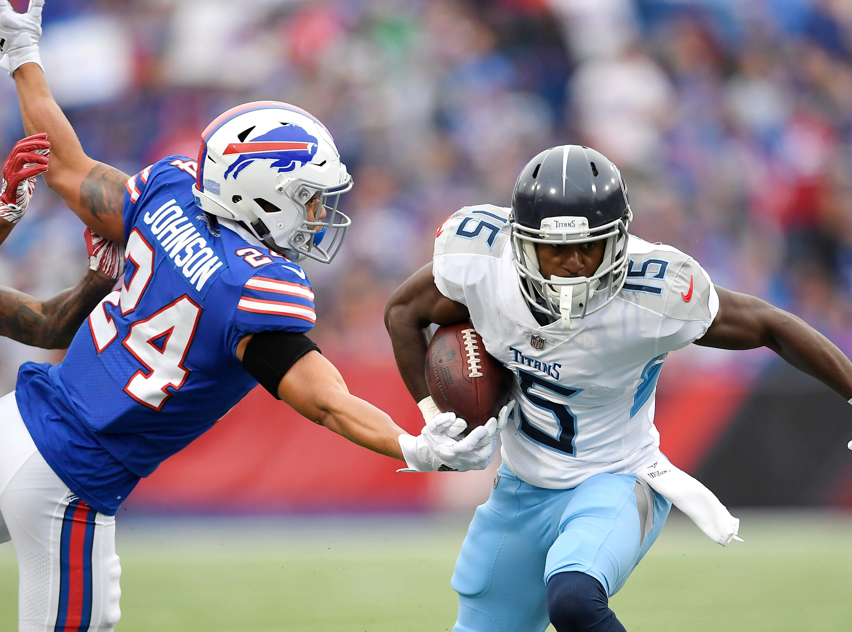 Tennessee Titans wide receiver Darius Jennings (15) runs for yardage as Buffalo Bills cornerback Taron Johnson (24) tries to bring him down during the second half of an NFL football game, Sunday, Oct. 7, 2018, in Orchard Park, N.Y. (AP Photo/Adrian Kraus)
