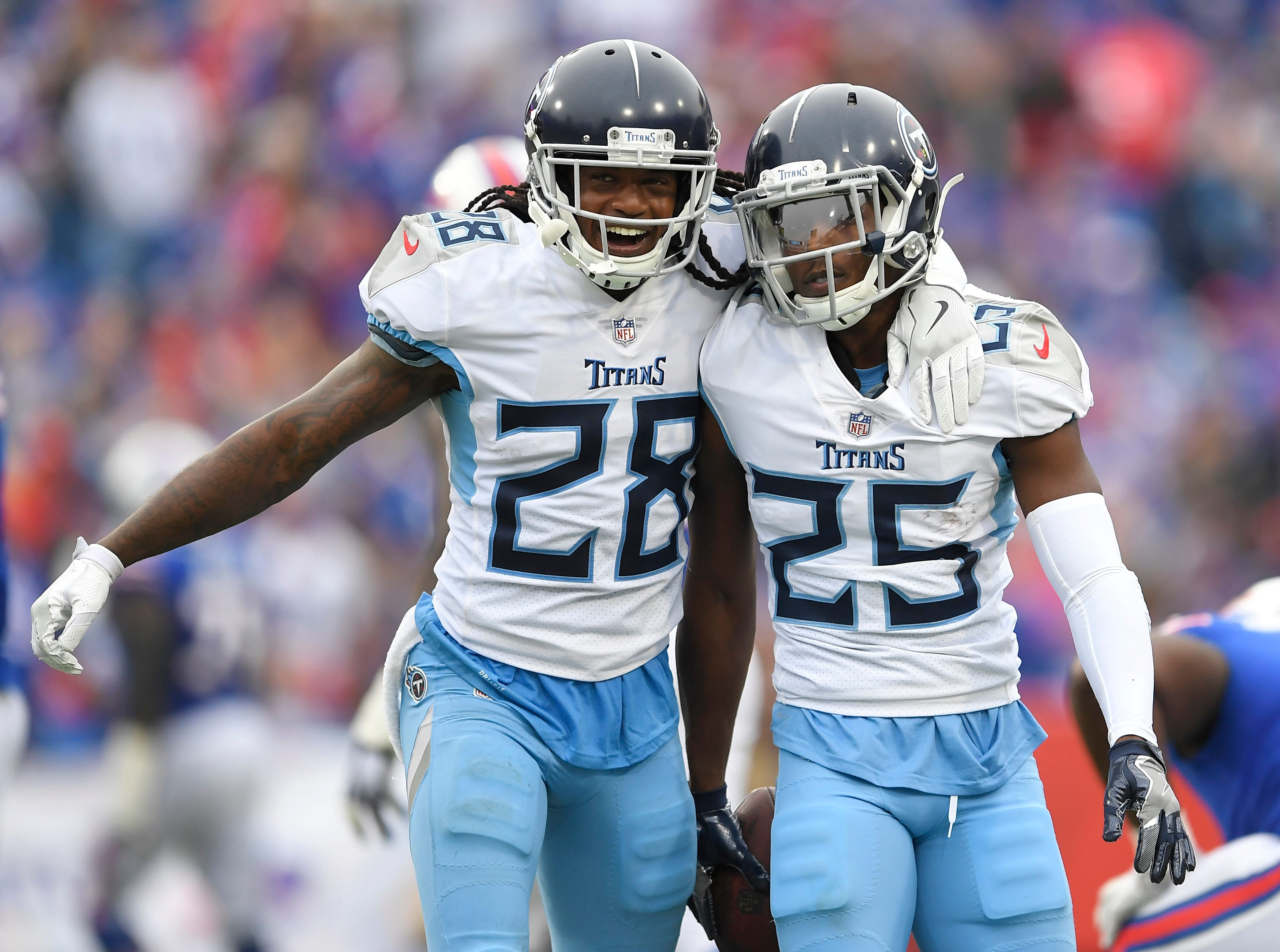 Tennessee Titans cornerback Adoree' Jackson (25) celebrates his interception on a pass from Buffalo Bills quarterback Josh Allen, not pictured, with defensive back Kendrick Lewis (28) during the second half of an NFL football game, Sunday, Oct. 7, 2018, in Orchard Park, N.Y. (AP Photo/Adrian Kraus)