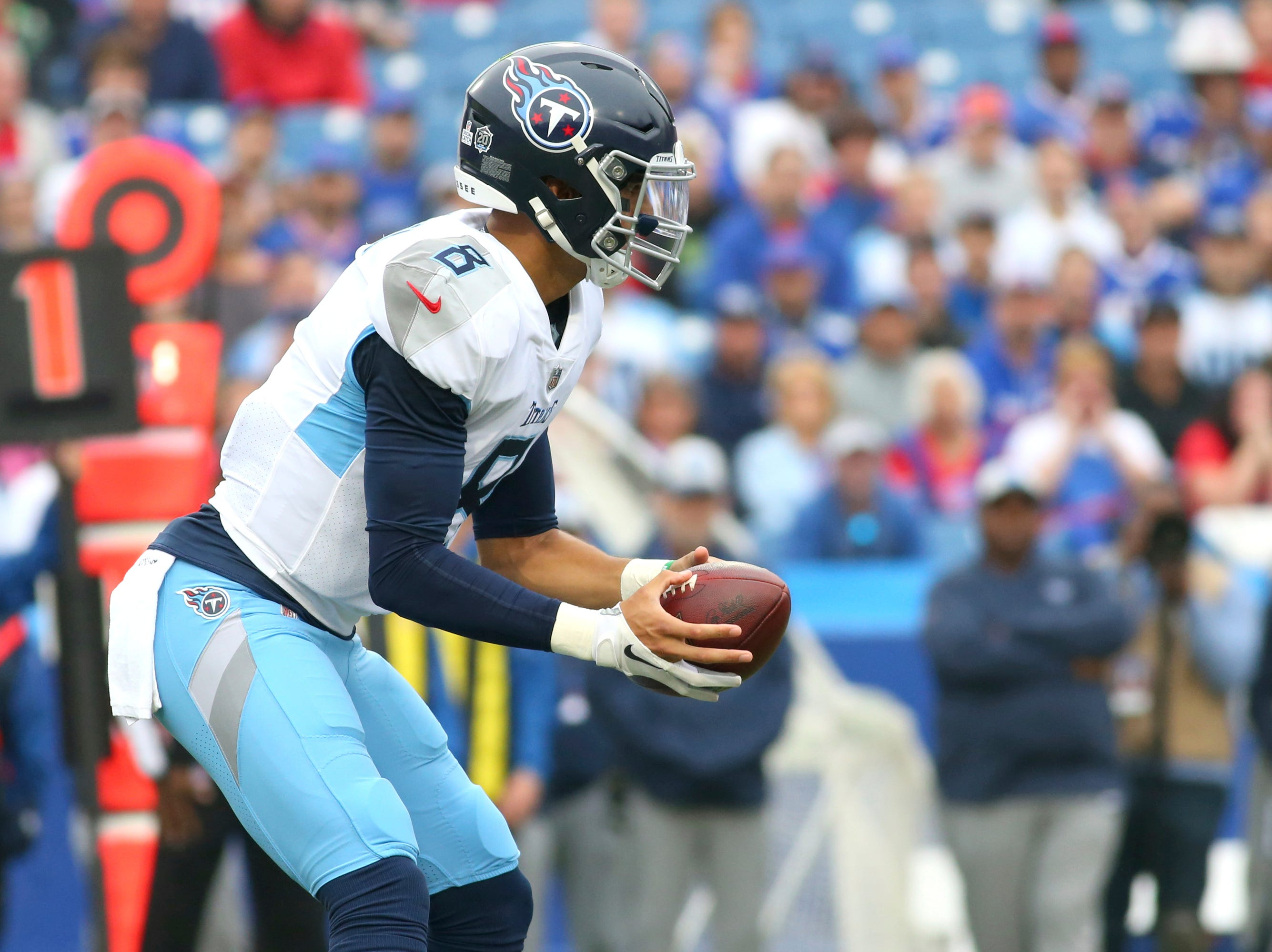 Tennessee Titans quarterback Marcus Mariota takes the first snap of the game during the first half of NFL football game against the Buffalo Bills, Sunday, Oct. 7, 2018, in Orchard Park, N.Y.