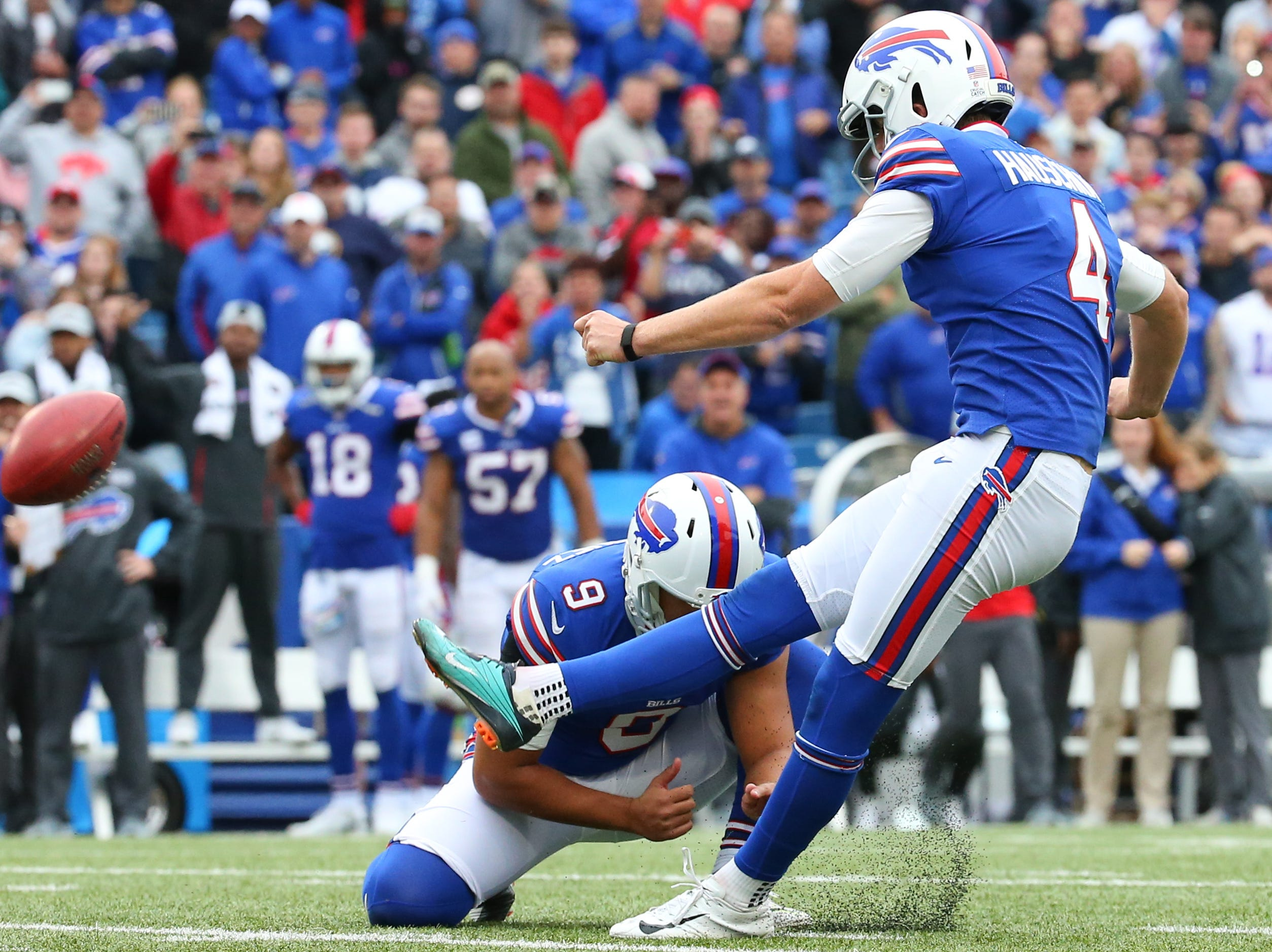 Oct 7, 2018; Orchard Park, NY, USA; Buffalo Bills kicker Stephen Hauschka (4) kicks the game winning field goal from the hold of punter Corey Bojorquez (9) against the Tennessee Titans during the fourth quarter at New Era Field.