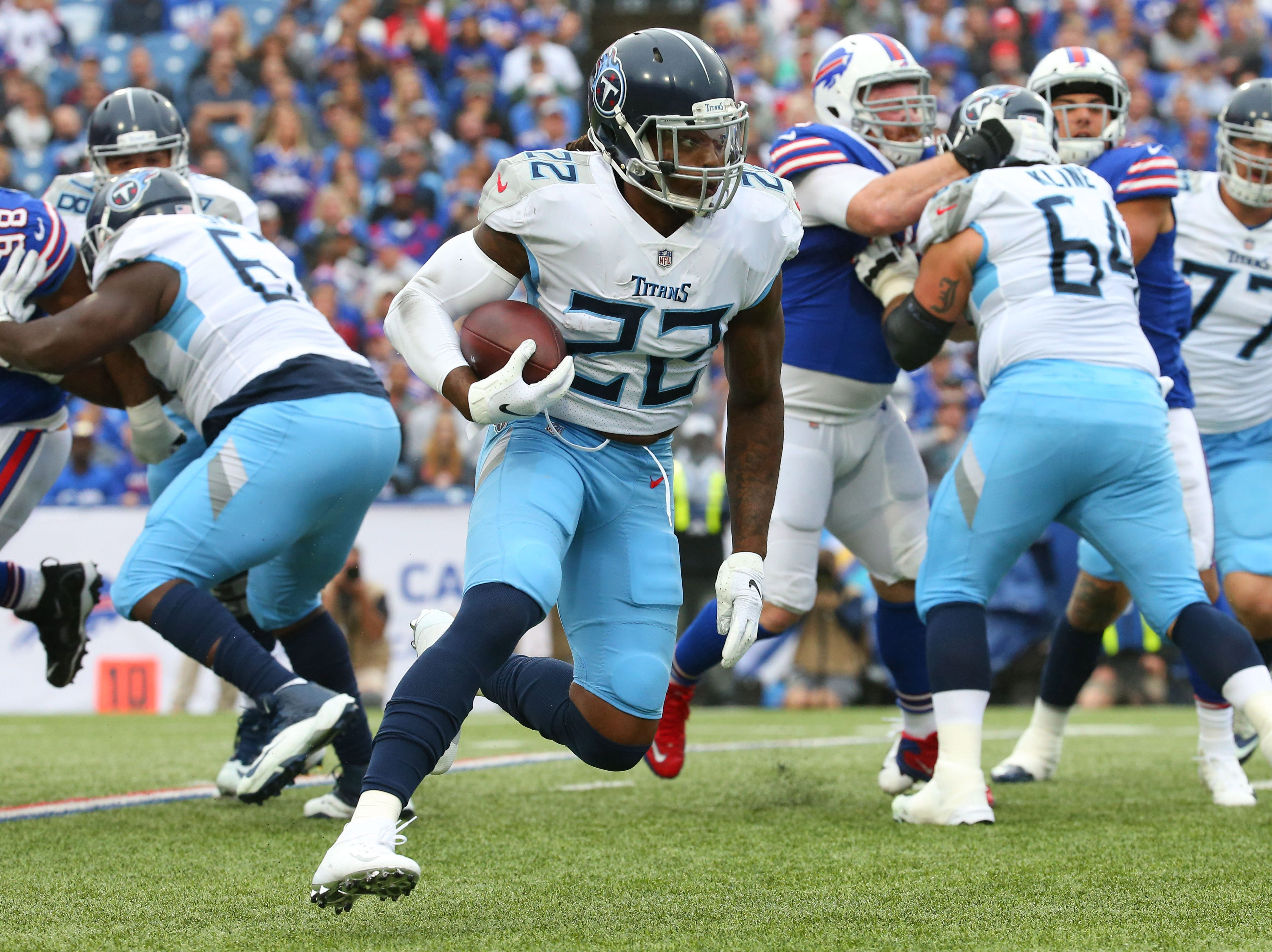 Oct 7, 2018; Orchard Park, NY, USA; Tennessee Titans running back Derrick Henry (22) runs with the ball against the Buffalo Bills during the second quarter at New Era Field.