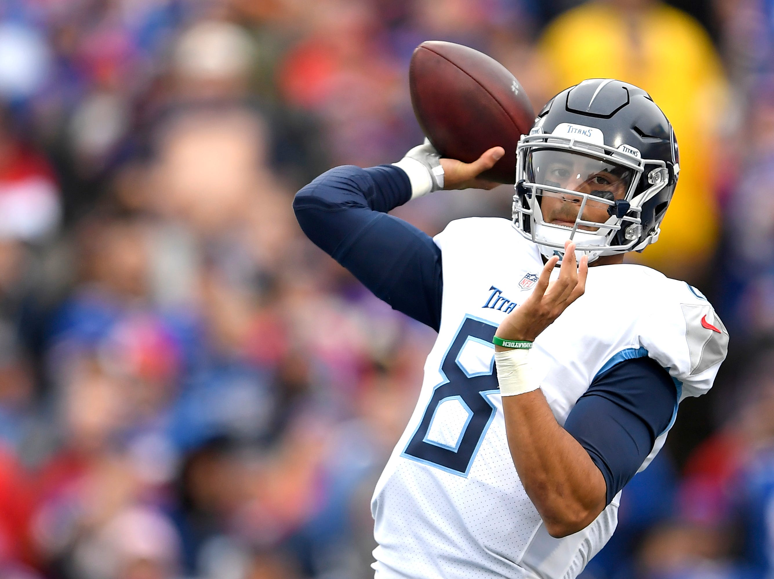 Tennessee Titans quarterback Marcus Mariota throws a pass against the Buffalo Bills during the second half of an NFL football game, Sunday, Oct. 7, 2018, in Orchard Park, N.Y. (AP Photo/Adrian Kraus)