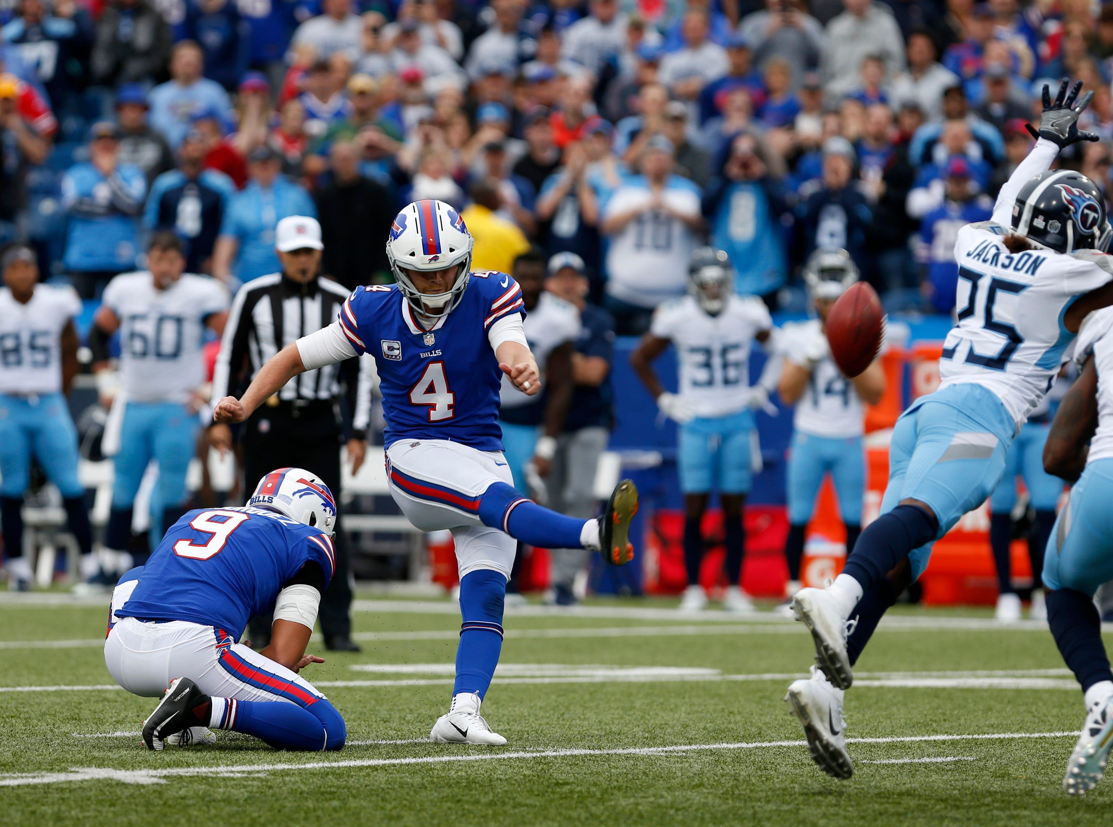 Oct 7, 2018; Orchard Park, NY, USA; Buffalo Bills kicker Stephen Hauschka (4) kicks the game winning field goal against the Tennessee Titans during the second half at New Era Field.