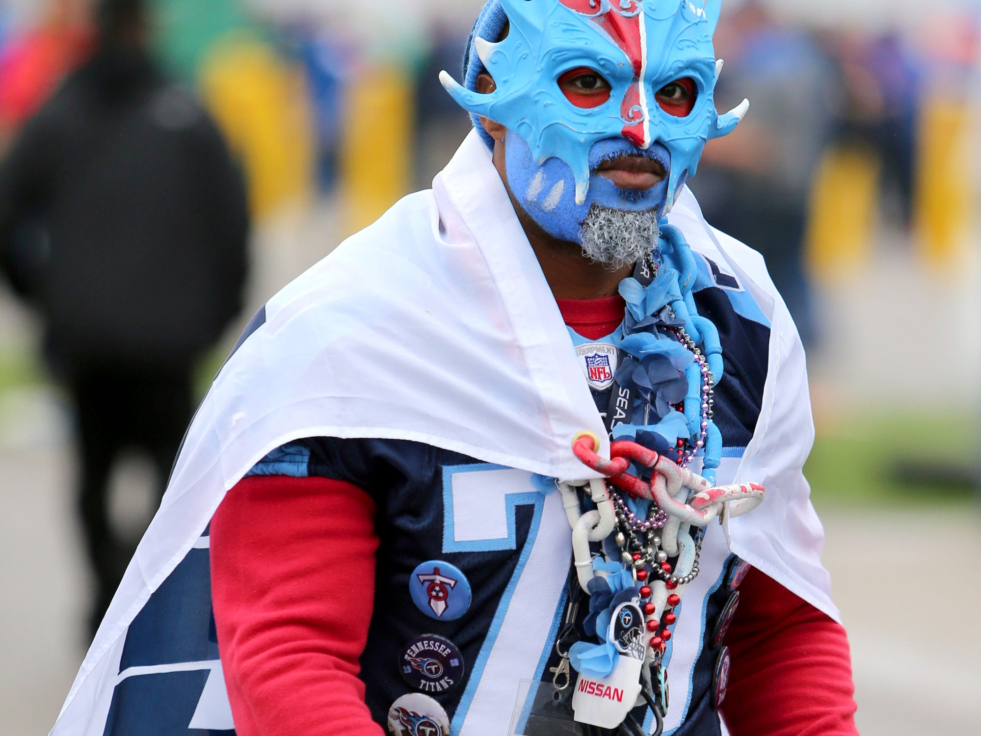 Jarremy Gooden of Nashville, Tenn., walks on the parking lot of New Era Field while tailgating prior to an NFL football game between the Buffalo Bills and the Tennessee Titans, Sunday, Oct. 7, 2018, in Orchard Park, N.Y. (AP Photo/Jeffrey T. Barnes)