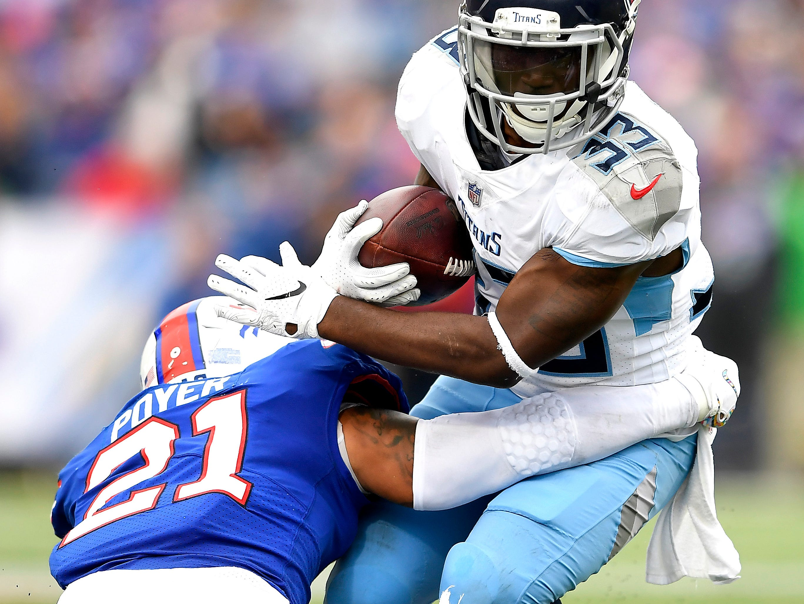 Buffalo Bills free safety Jordan Poyer (21) applies a tackle on Tennessee Titans running back Dion Lewis (33) during the second half of an NFL football game, Sunday, Oct. 7, 2018, in Orchard Park, N.Y. The Bills won 13-12. (AP Photo/Adrian Kraus)