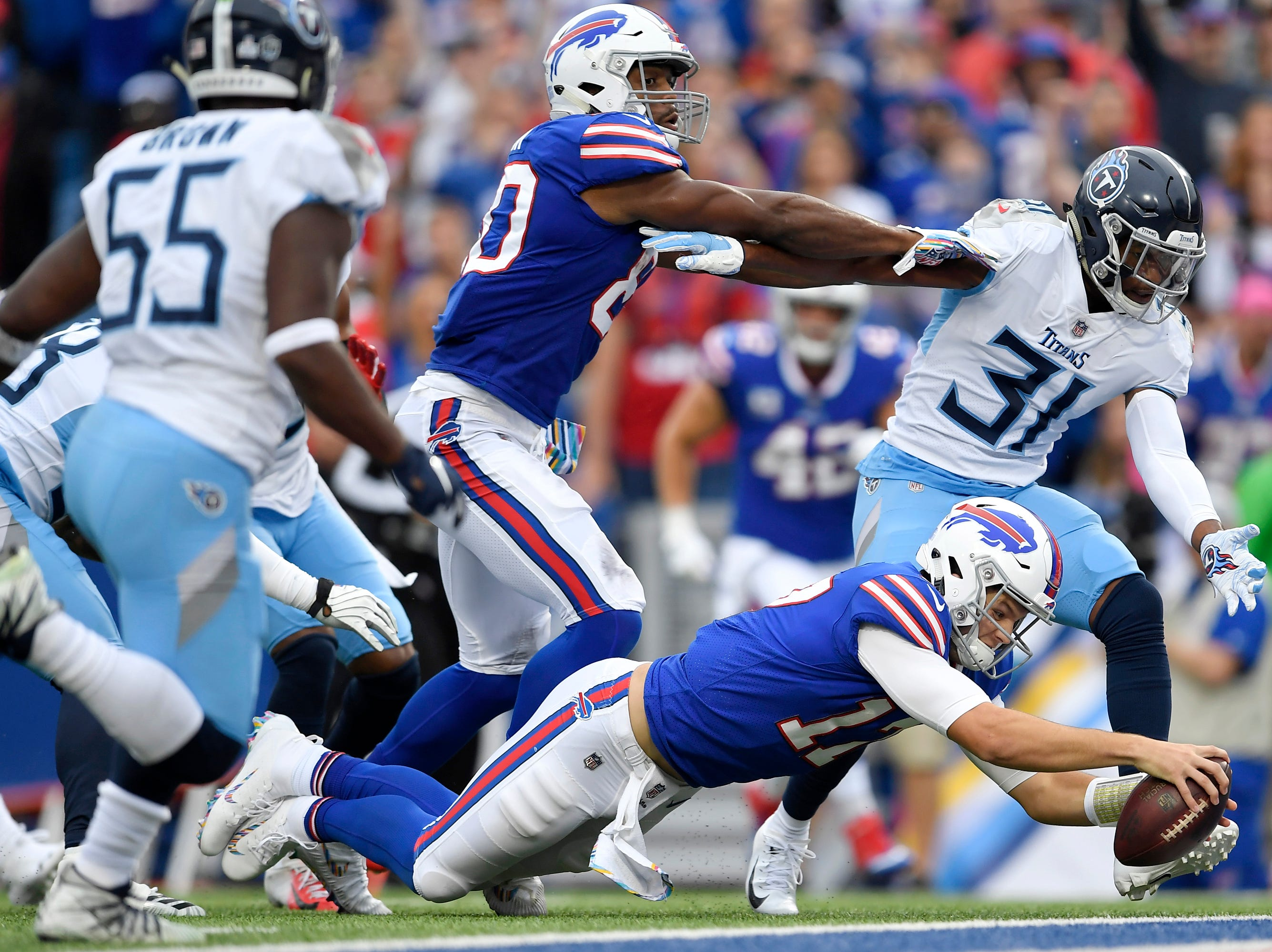 Buffalo Bills quarterback Josh Allen (17) dives in for a touchdown run against the Tennessee Titans during the first half of an NFL football game, Sunday, Oct. 7, 2018, in Orchard Park, N.Y.