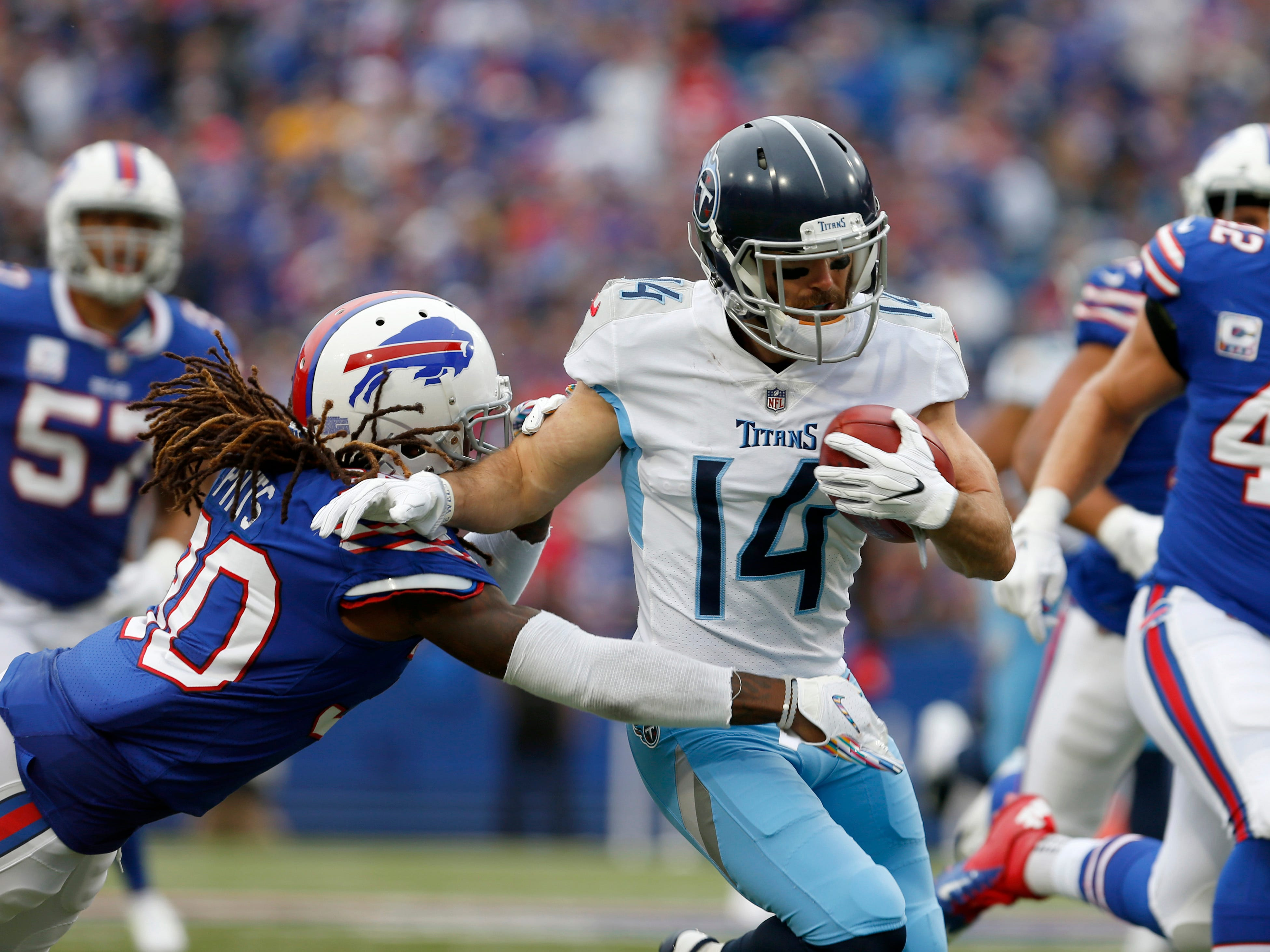 Oct 7, 2018; Orchard Park, NY, USA; Tennessee Titans wide receiver Nick Williams (14) as he runs back the ball against Buffalo Bills cornerback Lafayette Pitts (30) during the first half at New Era Field.