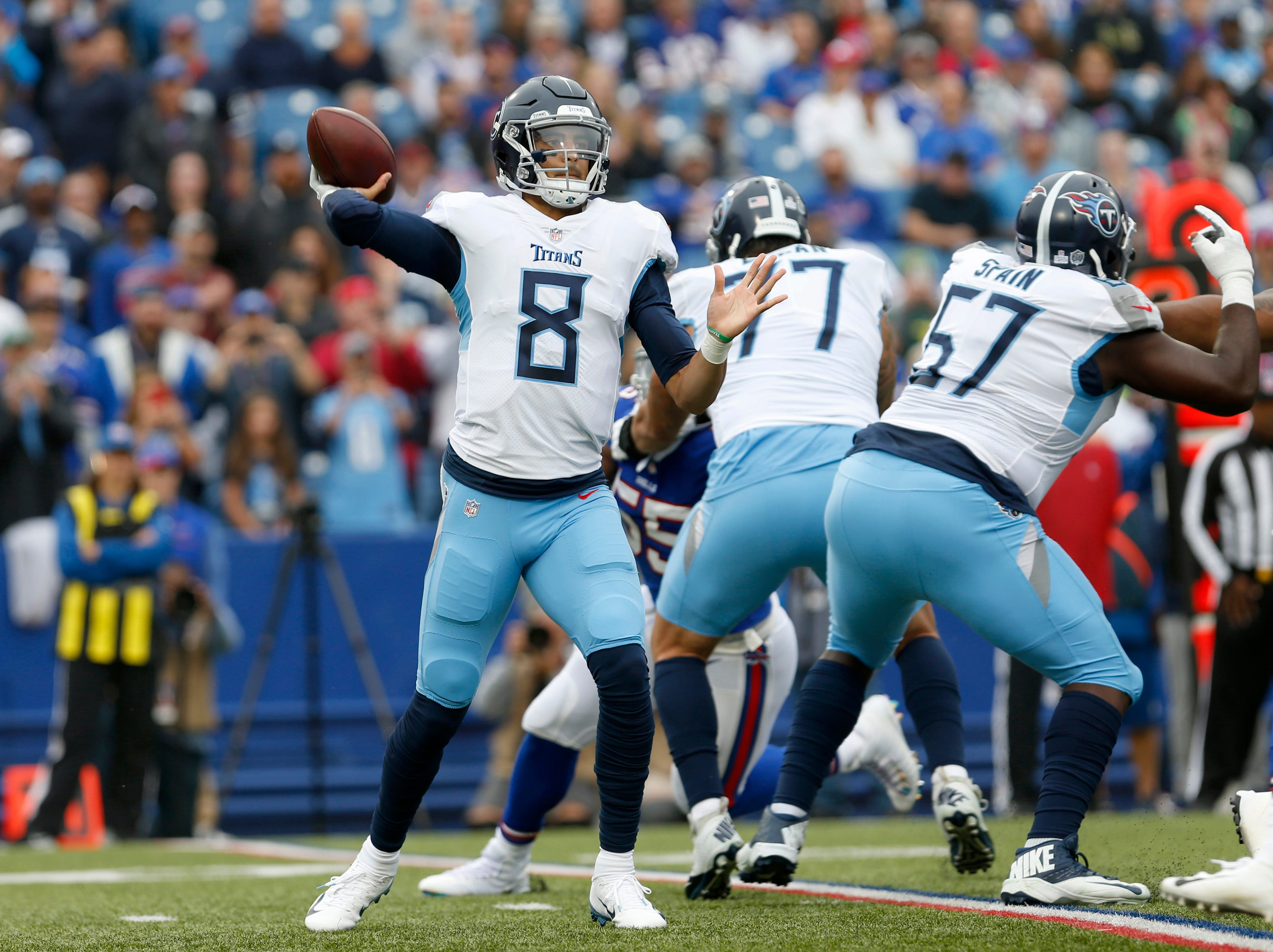 Oct 7, 2018; Orchard Park, NY, USA; Tennessee Titans quarterback Marcus Mariota (8) throws a pass during the first half against the Buffalo Bills at New Era Field.