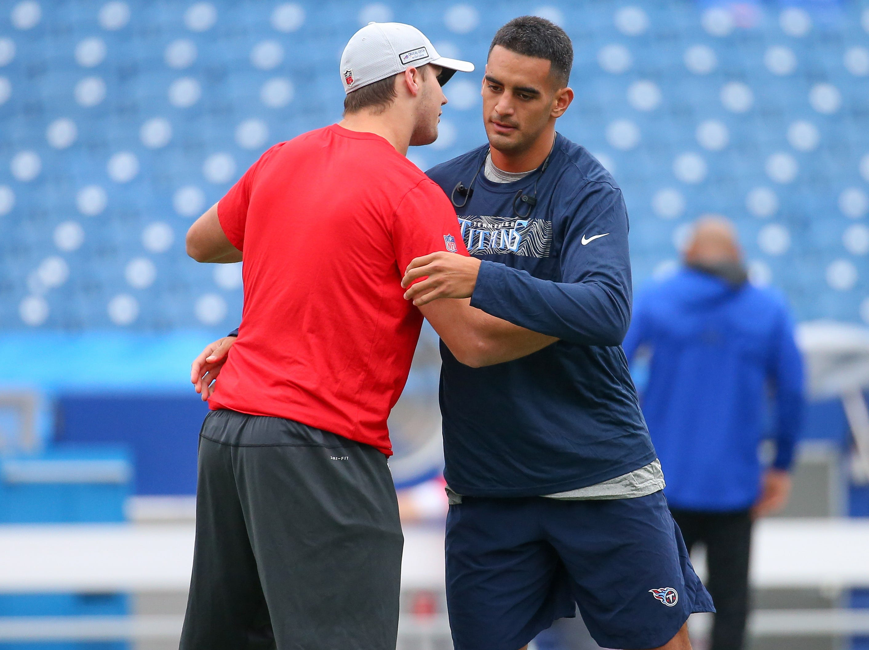 Oct 7, 2018; Orchard Park, NY, USA; Buffalo Bills quarterback Josh Allen (L) and Tennessee Titans quarterback Marcus Mariota (R) meet on the field prior to the game at New Era Field.