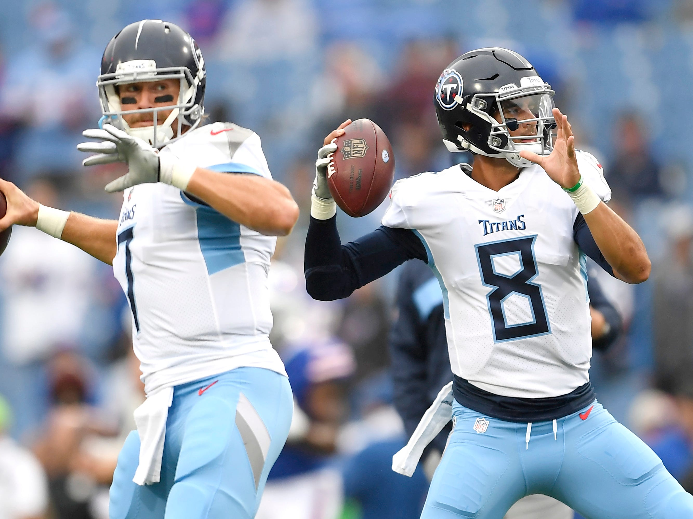 Tennessee Titans quarterback Marcus Mariota (8) and quarterback Blaine Gabbert (7) work out prior to an NFL football game against the Buffalo Bills, Sunday, Oct. 7, 2018, in Orchard Park, N.Y. (AP Photo/Adrian Kraus)
