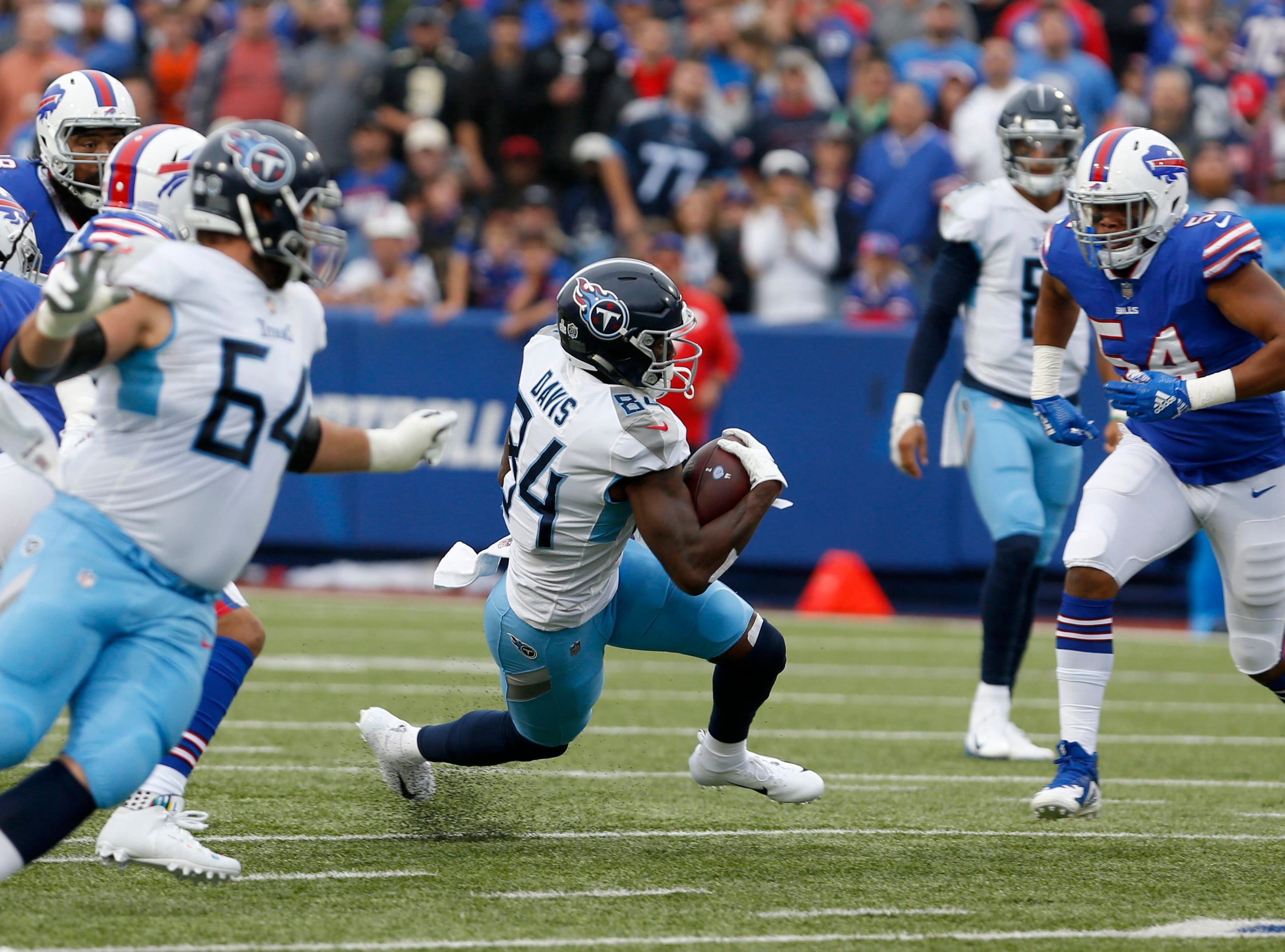 Oct 7, 2018; Orchard Park, NY, USA; Tennessee Titans wide receiver Corey Davis (84) runs the ball after a catch against Buffalo Bills defensive end Eddie Yarbrough (54) during the first half at New Era Field.