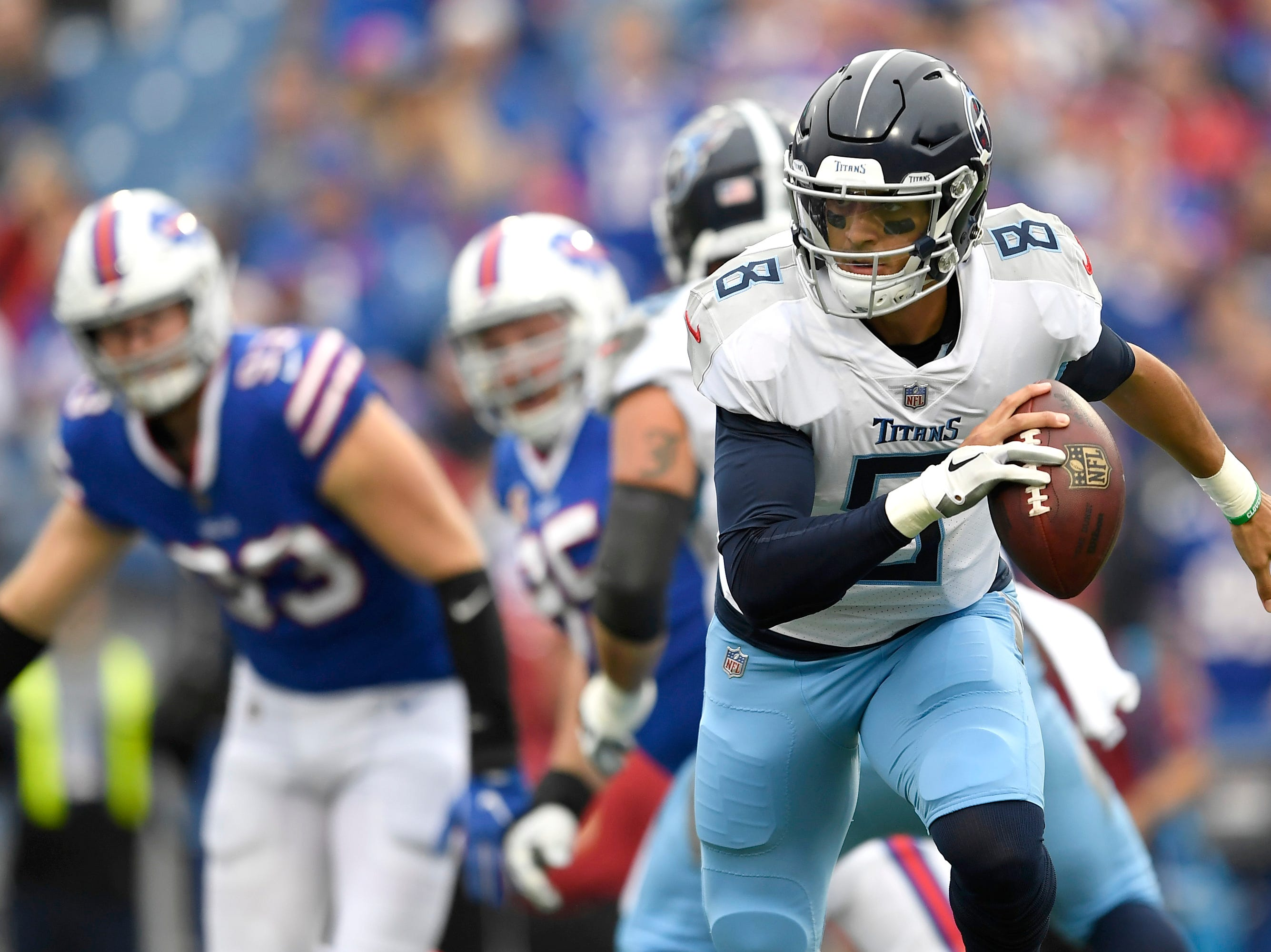 Tennessee Titans quarterback Marcus Mariota scrambles against the Buffalo Bills during the first half of an NFL football game, Sunday, Oct. 7, 2018, in Orchard Park, N.Y.
