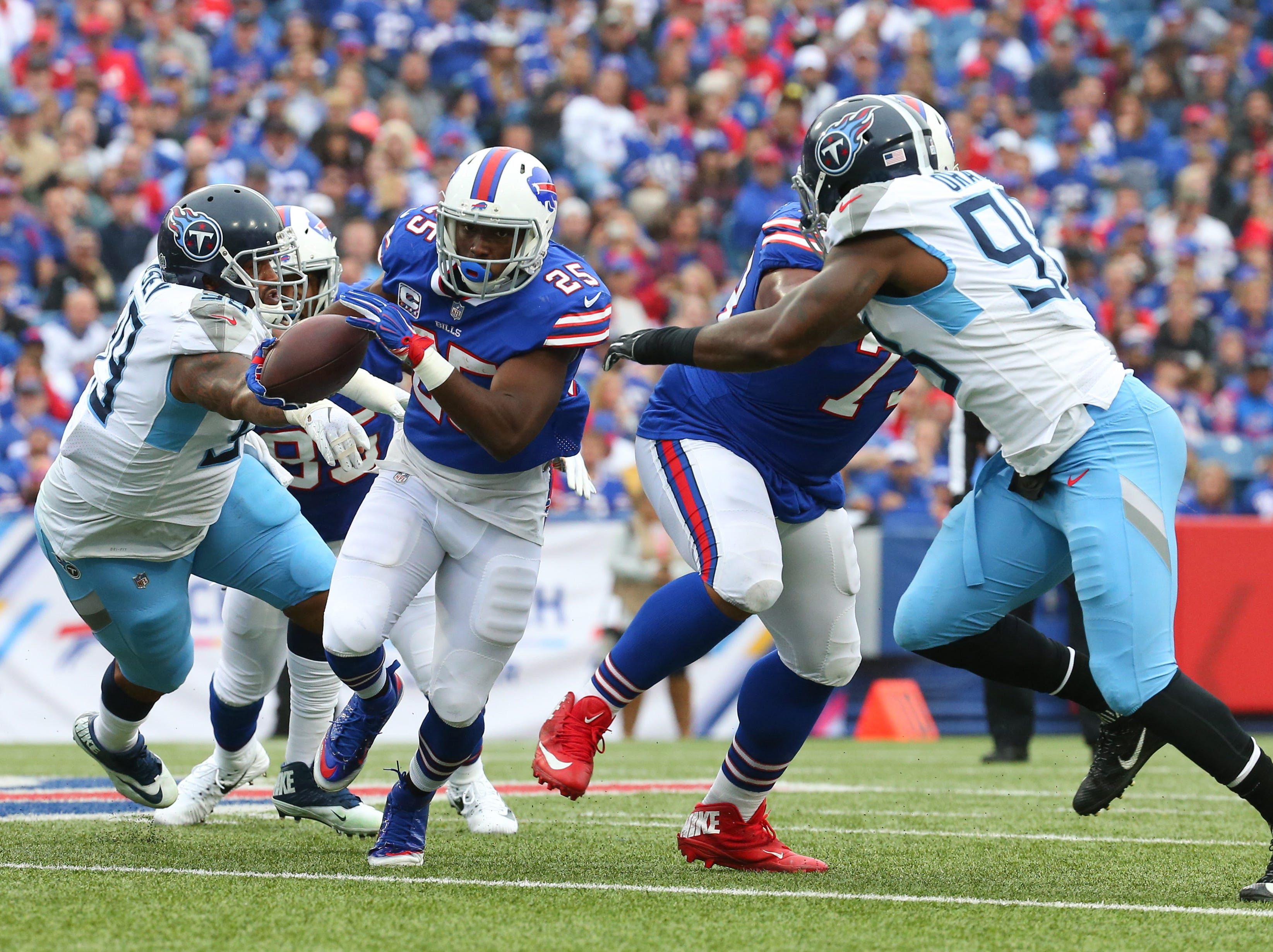 Oct 7, 2018; Orchard Park, NY, USA; Buffalo Bills running back LeSean McCoy (25) runs with the ball against the Tennessee Titans during the second quarter at New Era Field.