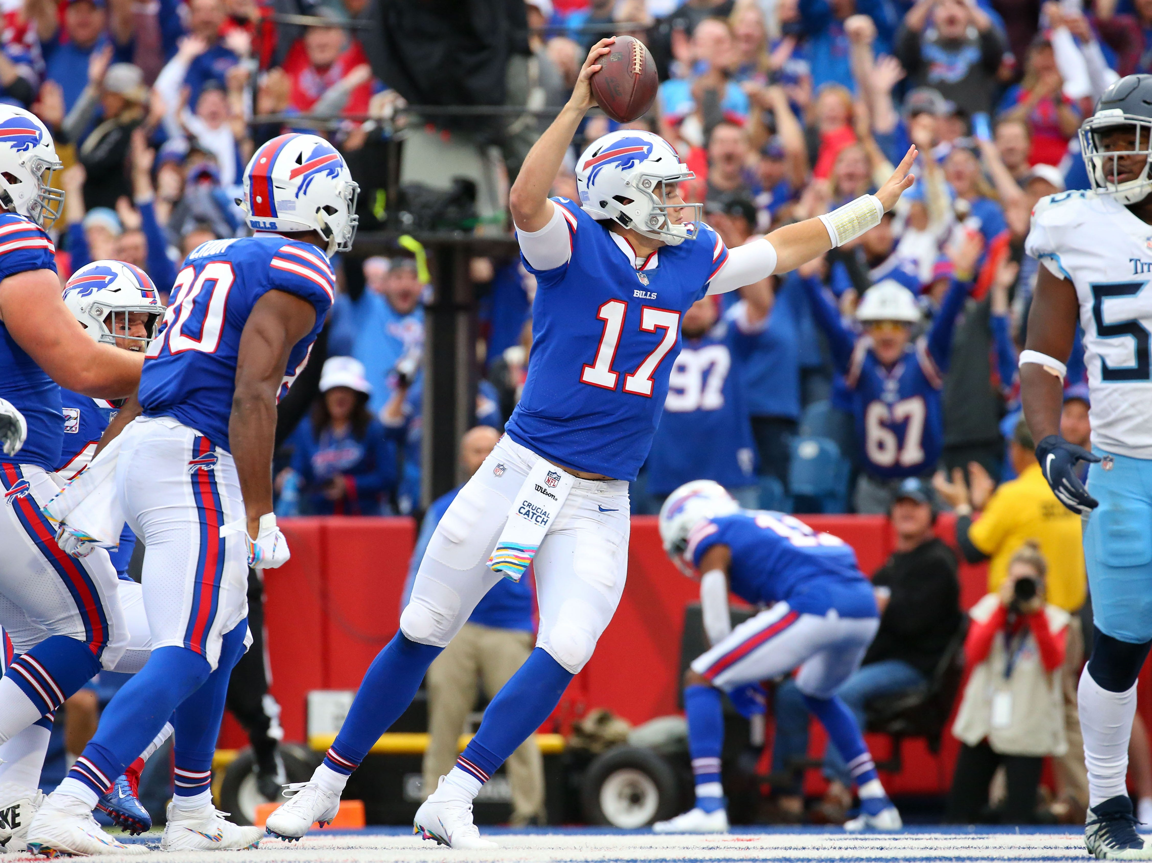 Oct 7, 2018; Orchard Park, NY, USA; Buffalo Bills quarterback Josh Allen (17) celebrates after making a touchdown run against the Tennessee Titans during the first quarter at New Era Field.