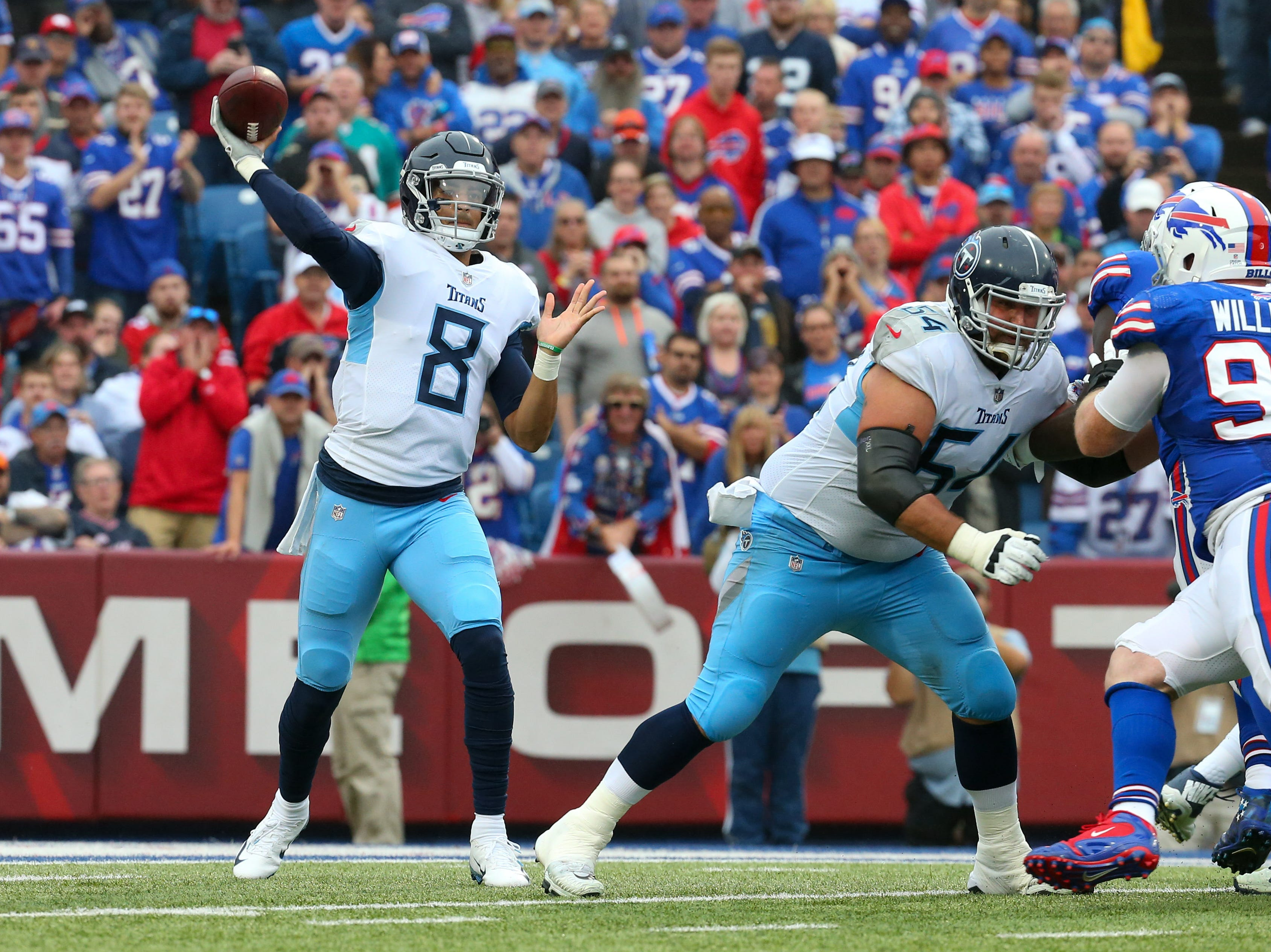 Oct 7, 2018; Orchard Park, NY, USA; Tennessee Titans quarterback Marcus Mariota (8) passes the ball as Buffalo Bills defensive tackle Kyle Williams (95) rushes during the second quarter at New Era Field.