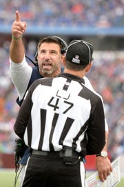 Tennessee Titans head coach Mike Vrabel, left, talks to line judge Tim Podraza (47) during the second half of an NFL football game, Sunday, Oct. 7, 2018, in Orchard Park, N.Y. (AP Photo/Adrian Kraus)