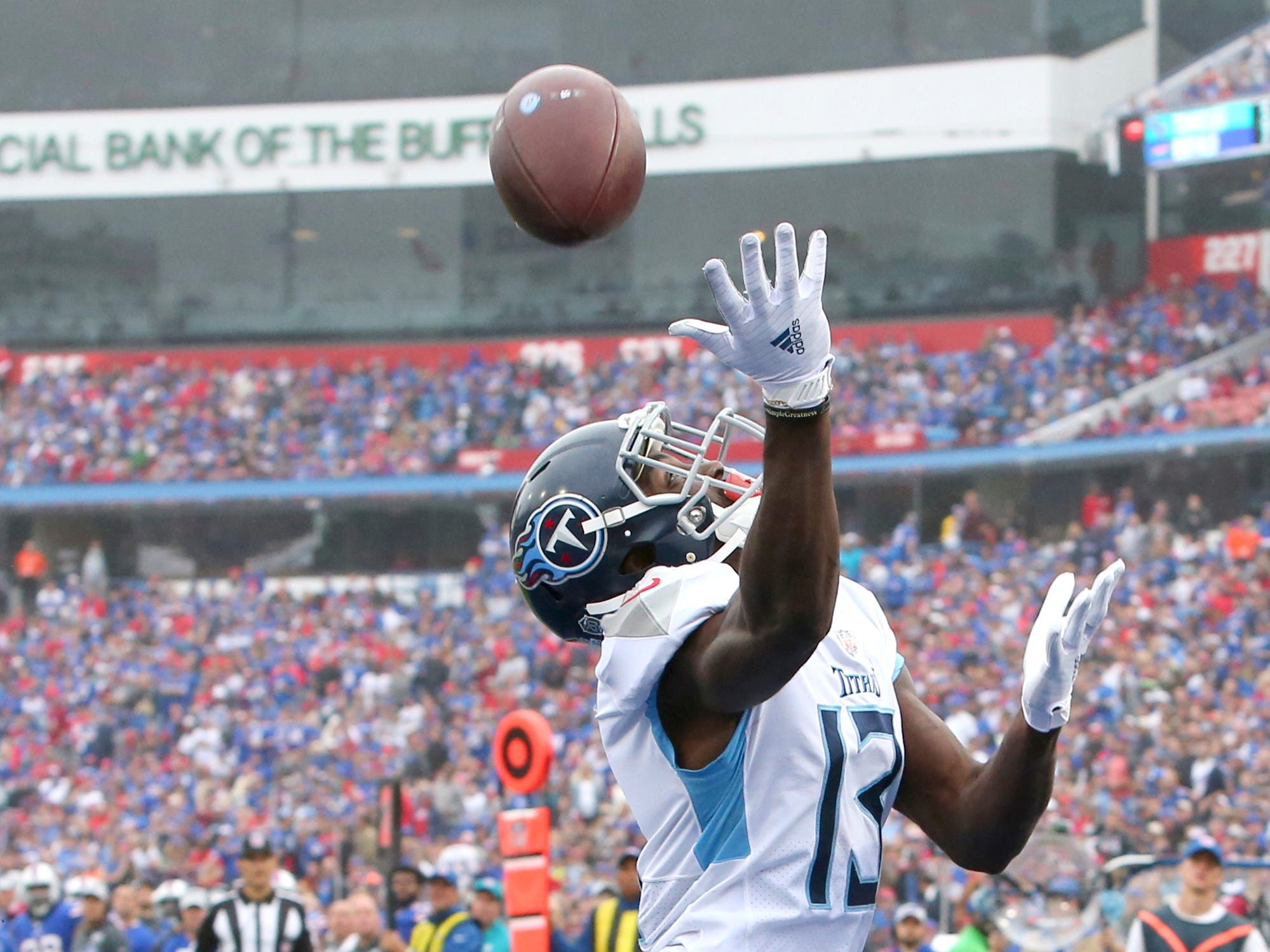 Tennessee Titans wide receiver Taywan Taylor (13) is unable to catch a pass from quarterback Marcus Mariota, not pictured, during the first half of an NFL football game against the Buffalo Bills, Sunday, Oct. 7, 2018, in Orchard Park, N.Y.