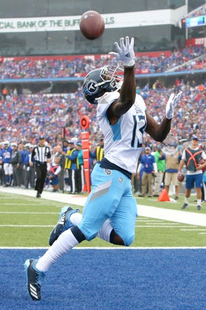 Titans wide receiver Taywan Taylor is unable to catch a pass from quarterback Marcus Mariota, not pictured, during the first half Sunday.