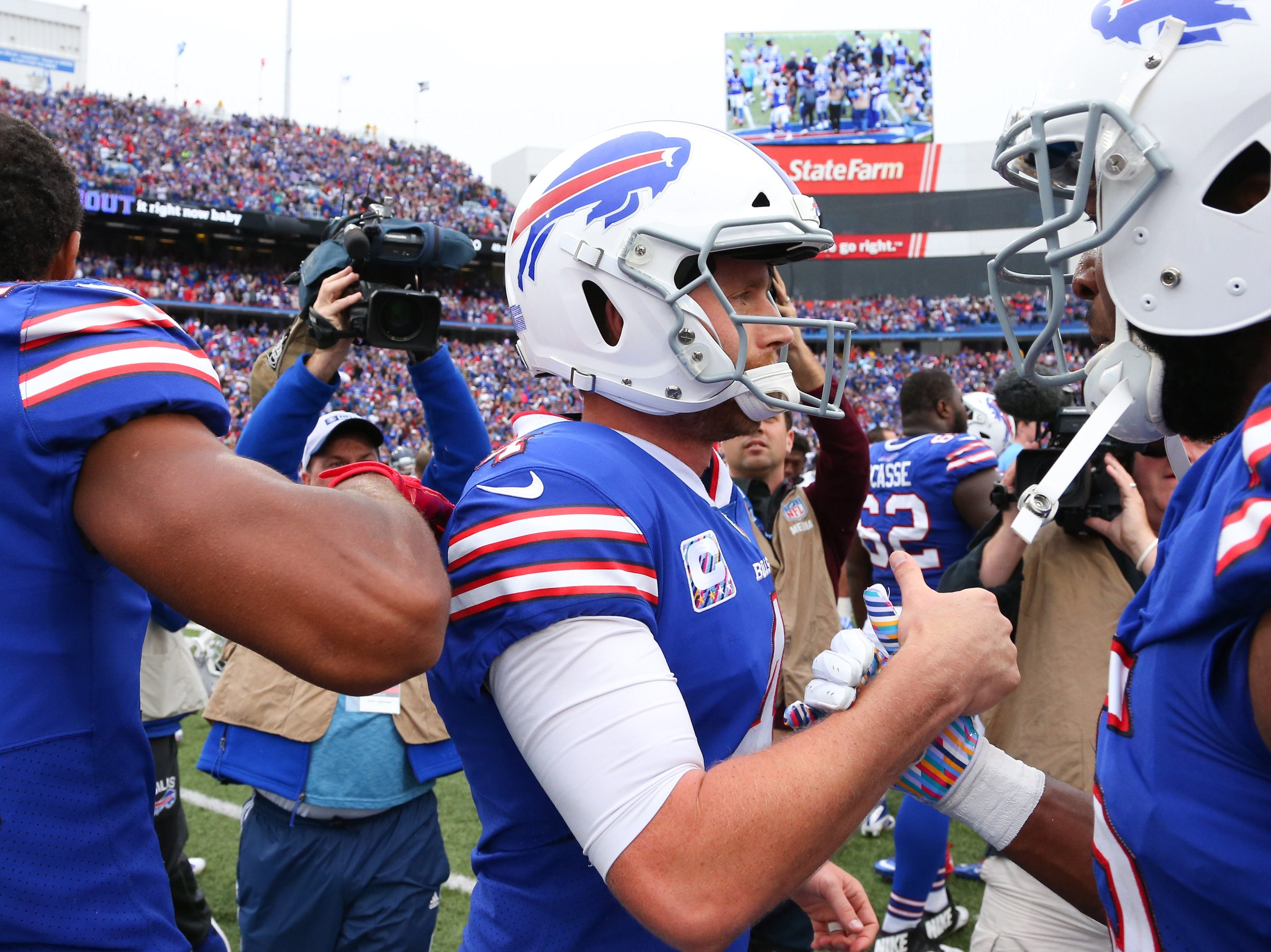 Oct 7, 2018; Orchard Park, NY, USA; Buffalo Bills kicker Stephen Hauschka (4) celebrates after kicking a game winning field goal against the Tennessee Titans at New Era Field.