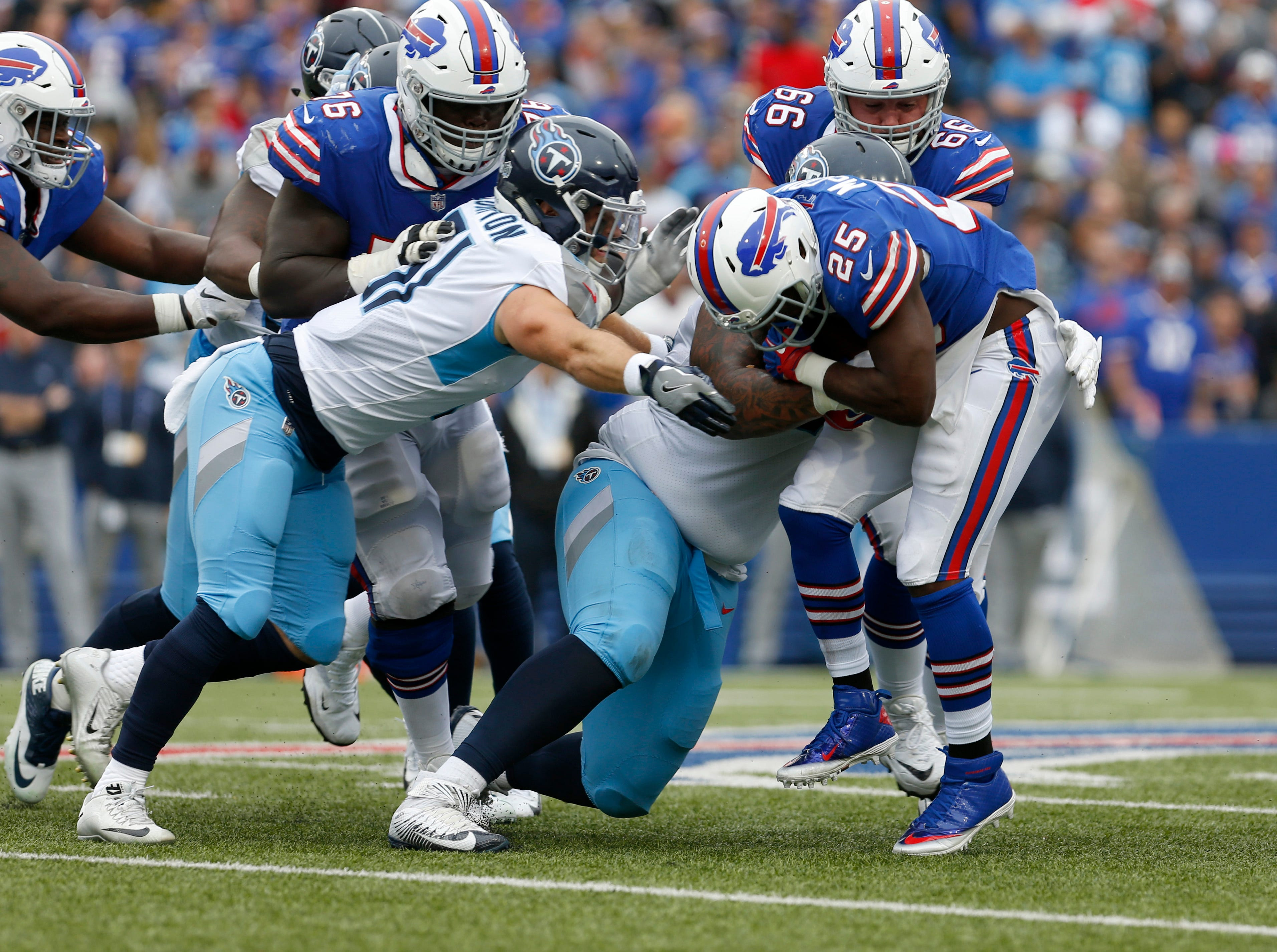 Oct 7, 2018; Orchard Park, NY, USA; Buffalo Bills running back LeSean McCoy (25) is tackled by Tennessee Titans linebacker Will Compton (51) during the second half at New Era Field.