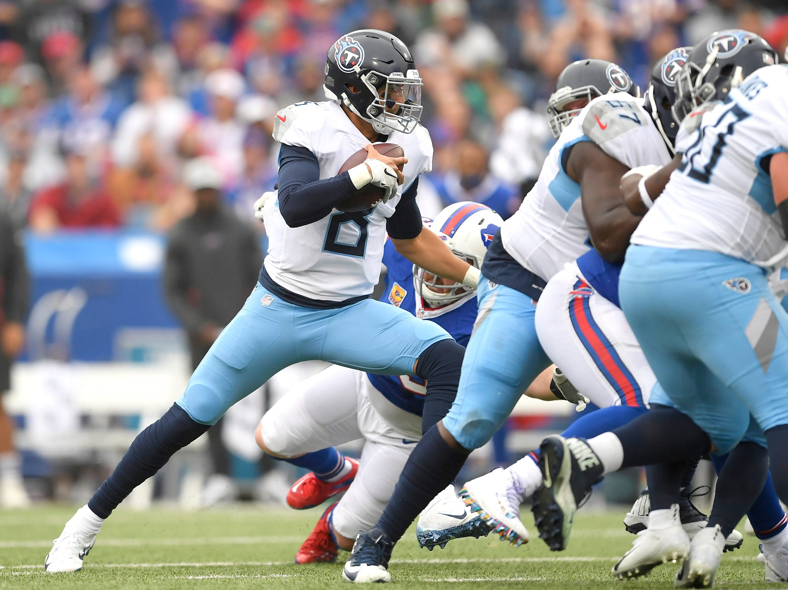 Tennessee Titans quarterback Marcus Mariota (8) scrambles against the Buffalo Bills during the first half of an NFL football game, Sunday, Oct. 7, 2018, in Orchard Park, N.Y. (AP Photo/Adrian Kraus)