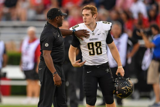 Oct 6, 2018; Athens, GA, USA; Vanderbilt Commodores head coach Derek Mason talks with place kicker Ryley Guay (98) prior to the game against the Georgia Bulldogs at Sanford Stadium. Mandatory Credit: Dale Zanine-USA TODAY Sports
