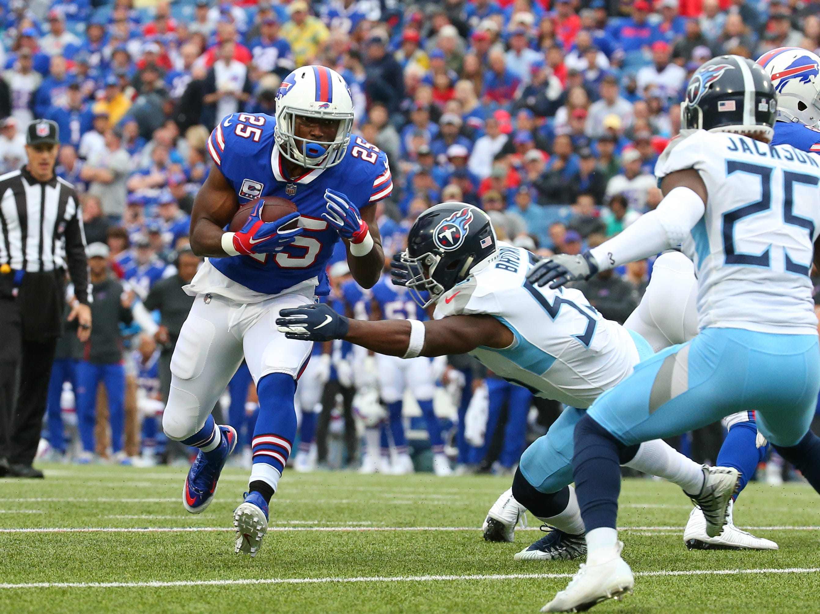 Oct 7, 2018; Orchard Park, NY, USA; Buffalo Bills running back LeSean McCoy (25) runs with the ball against Tennessee Titans linebacker Jayon Brown (55) during the first quarter at New Era Field.
