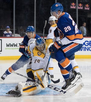 Nashville Predators goaltender Juuse Saros (74) makes the save against New York Islanders center Brock Nelson (29) during the second period of an NHL hockey game, Saturday, Oct. 6, 2018, in New York.