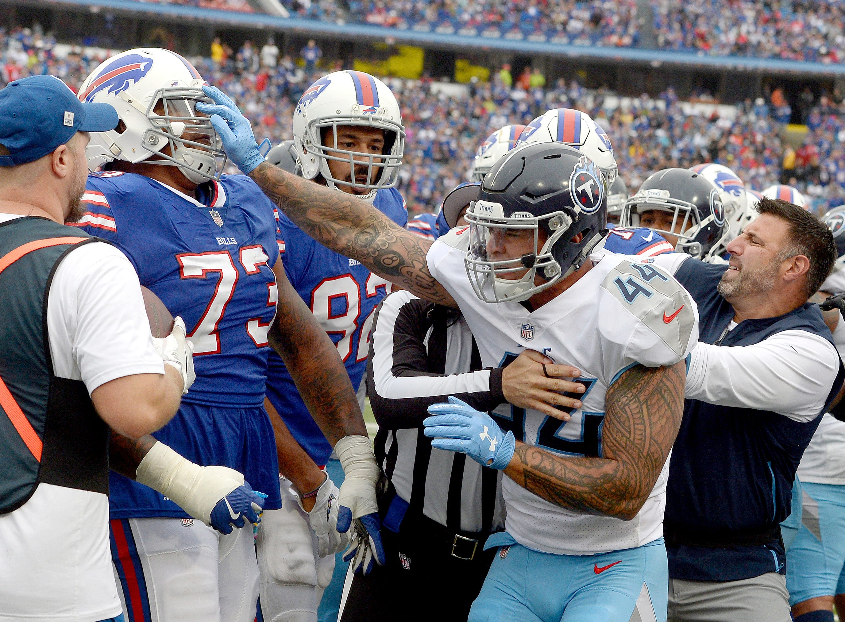 Oct. 14: Bills 13, Titans 12 --i Tennessee Titans head coach Mike Vrabel, right, tries to break up a fight between Titans' linebacker Kamalei Correa (44) and Buffalo Bills offensive tackle Dion Dawkins (73) during the second half of an NFL football game, Sunday, Oct. 7, 2018, in Orchard Park, N.Y. (AP Photo/Adrian Kraus)