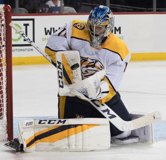 Nashville Predators goaltender Juuse Saros makes the save during the second period of an NHL hockey game against the New York Islanders, Saturday, Oct. 6, 2018, in New York.
