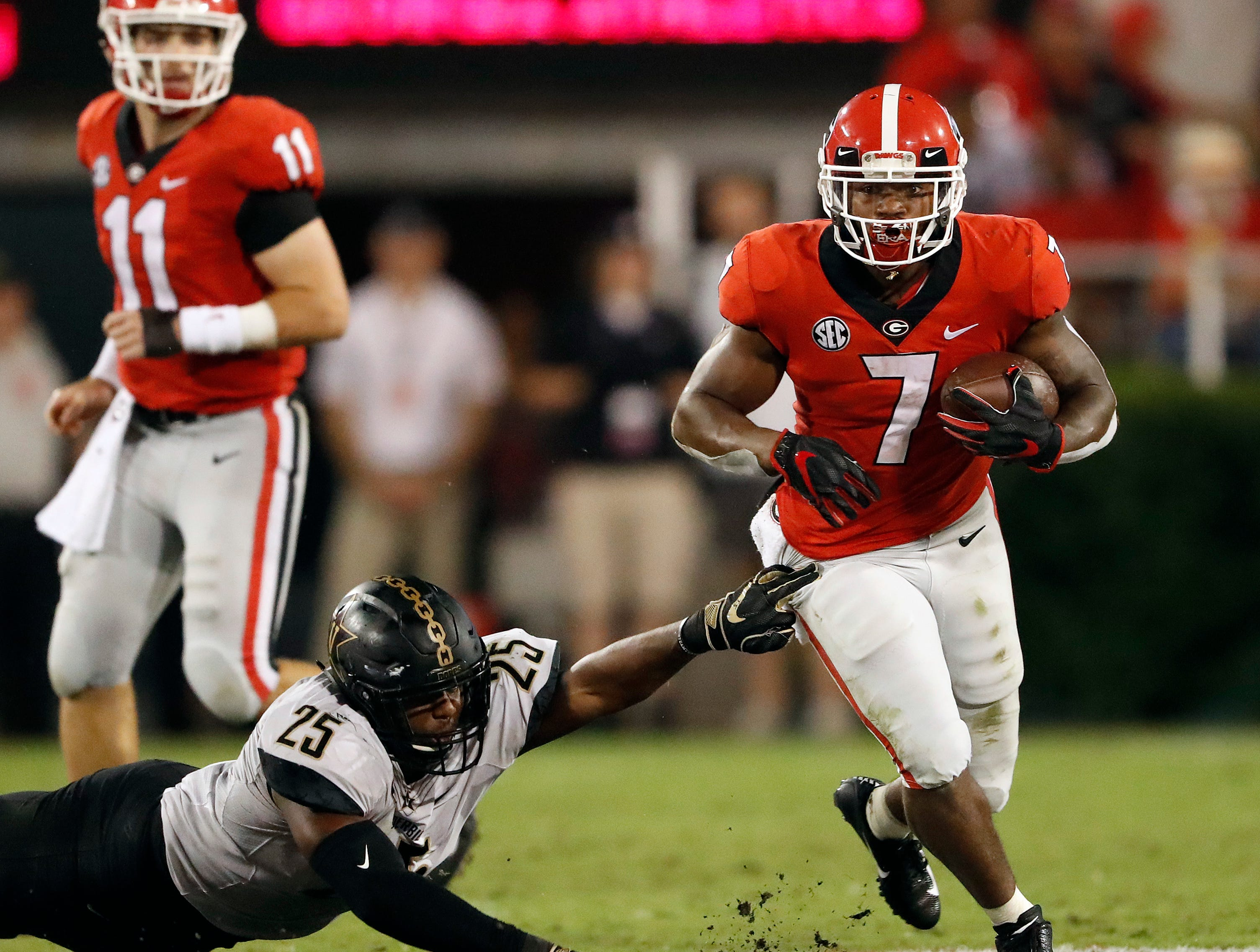Georgia running back D'Andre Swift (7) gets past Vanderbilt linebacker Josh Smith (25) during the second half of an NCAA college football game Saturday, Oct. 6, 2018, in Atlanta. (AP Photo/John Bazemore)