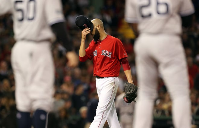 Oct 6, 2018; Boston, MA, USA; Boston Red Sox starting pitcher David Price (24) is pulled from the game in the second inning against the New York Yankees in game two of the 2018 ALDS playoff baseball series at Fenway Park.