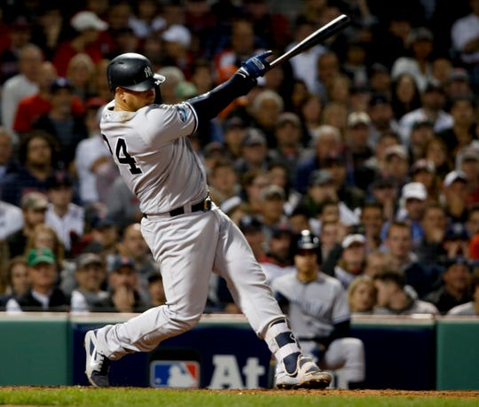 New York Yankees' Gary Sanchez watches his three-run home run against the Boston Red Sox during the seventh inning of Game 2 of a baseball American League Division Series, Saturday, Oct. 6, 2018, in Boston.