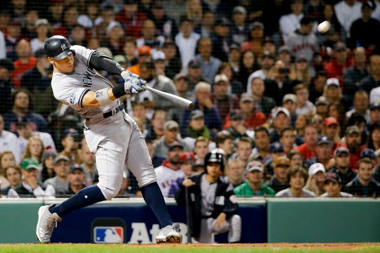 New York Yankees' Aaron Judge hits a home run against the Boston Red Sox during the first inning of Game 2 of a baseball American League Division Series, Saturday, Oct. 6, 2018, in Boston.