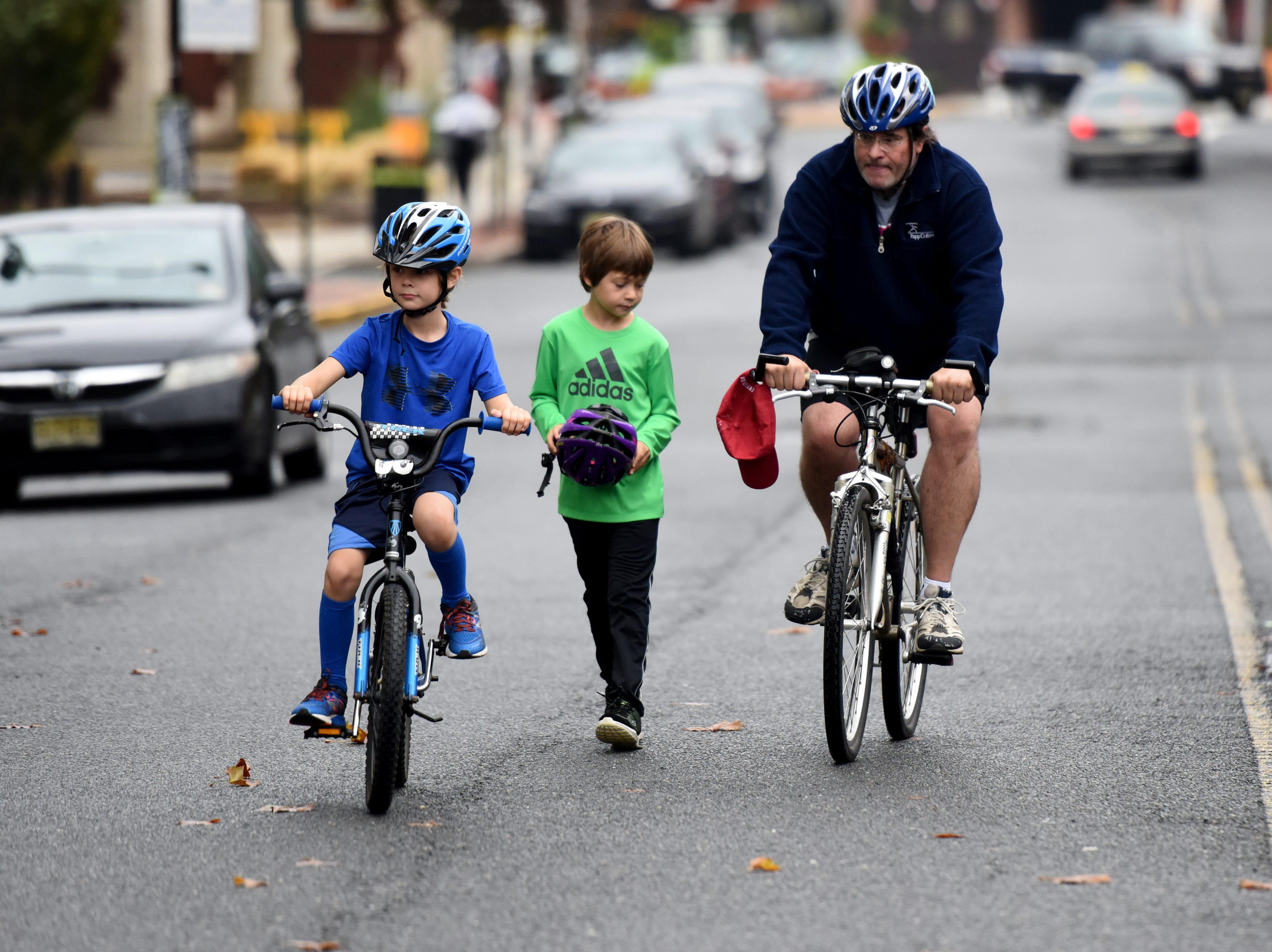 The Tour de Montclair a family-friendly bike ride with 6- and 12- mile options was held on Sunday, October 7, 2018. Cyclists leave for the ride next to Crane Park. Twins Charles and Julian Simpson 7 and their father George Simpson of Montclair arrive outside of Crane Park for the ride.