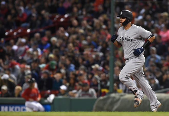 New York Yankees catcher Gary Sanchez (24) rounds the bases after hitting a home run against the Boston Red Sox at Fenway Park.