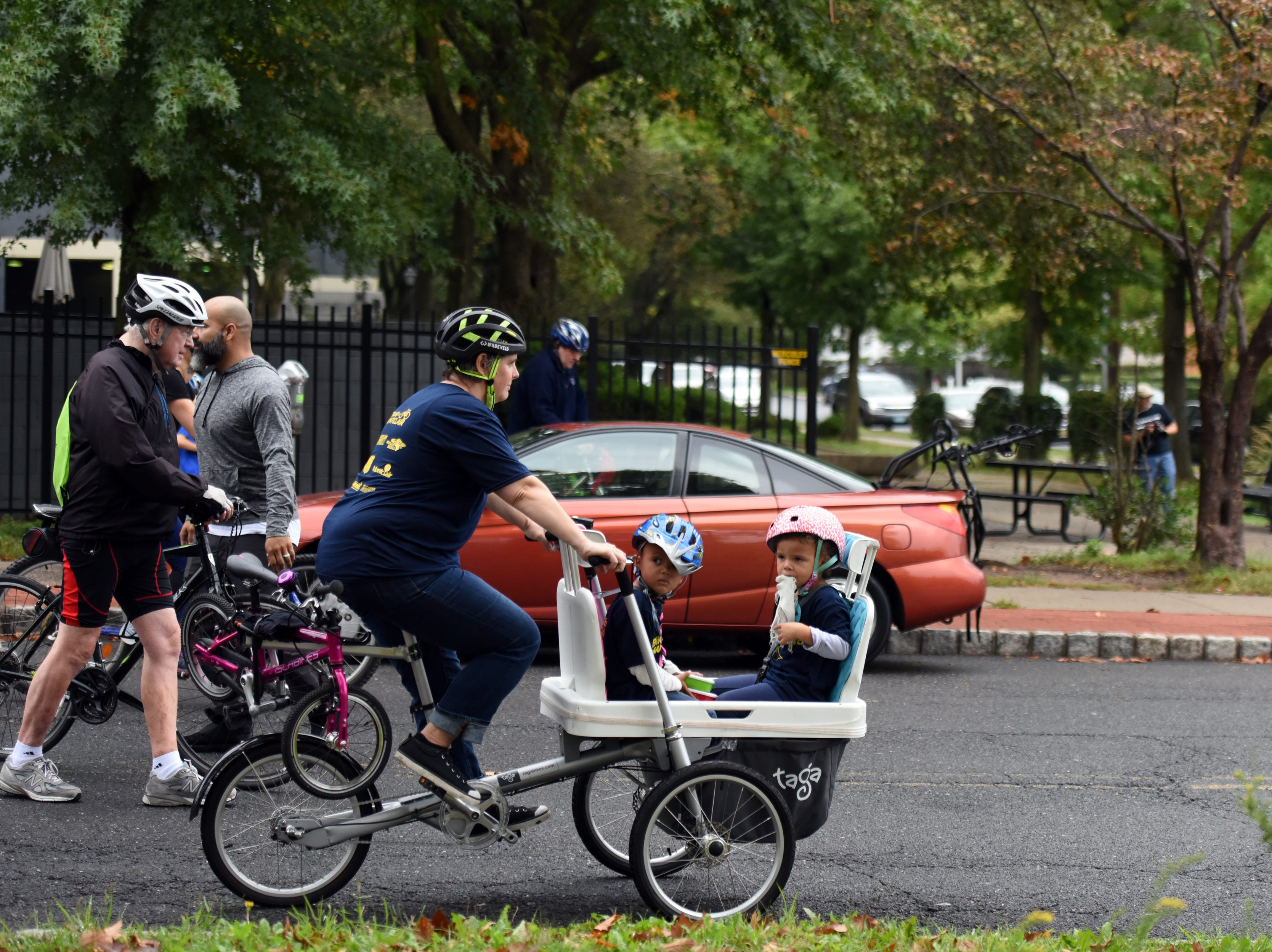The Tour de Montclair a family-friendly bike ride with 6- and 12- mile options was held on Sunday, October 7, 2018. Cyclists leave for the ride next to Crane Park. Alison Denby heads to the start line with her kids Vivian Page 4, and Aiden Page 3, in tow.