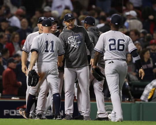 Oct 6, 2018; Boston, MA, USA; New York Yankees manager Aaron Boone (17) congratulates his team after defeating the Boston Red Sox in game two of the 2018 ALDS playoff baseball series at Fenway Park.
