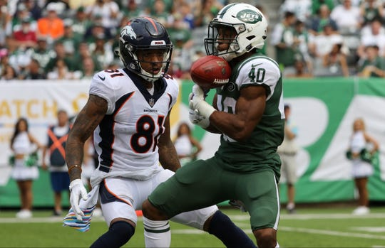 Trenton Cannon, of the Jets, catches a punt return in the second half. After the ball was dropped, a review of the play determined Cannon did have possession and the Jets kept the ball. Sunday, October 7, 2018