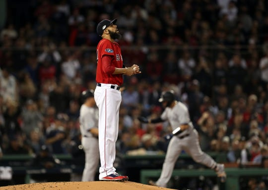 Oct 6, 2018; Boston, MA, USA; Boston Red Sox starting pitcher David Price (24) reacts after giving up a solo home run to New York Yankees catcher Gary Sanchez (24) during the second inning in game two of the 2018 ALDS playoff baseball series at Fenway Park.