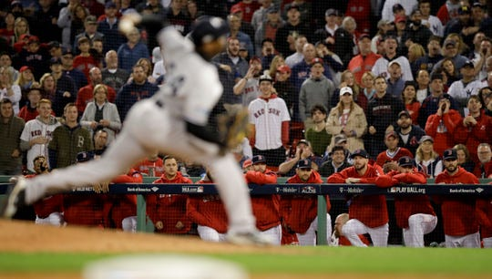 Boston Red Sox watch as New York Yankees relief pitcher Aroldis Chapman throws during the ninth inning of Game 2 of a baseball American League Division Series on Saturday, Oct. 6, 2018, in Boston.