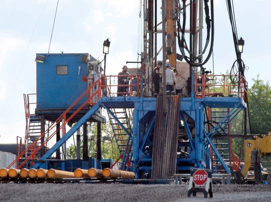 In this June 25, 2012 file photo, a crew works on a gas drilling rig at a well site for shale based natural gas in Zelienople, Pa. Gases from hydraulic fracturing are used to make plastics.