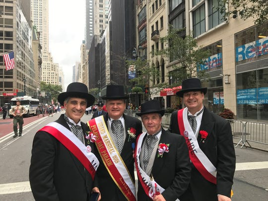 From left, Mayor Richard Rigoglioso, City Manager and Grand Marshal Tom Duch, Deputy Mayor Joe Delaney and clerk Drew Pavlica.